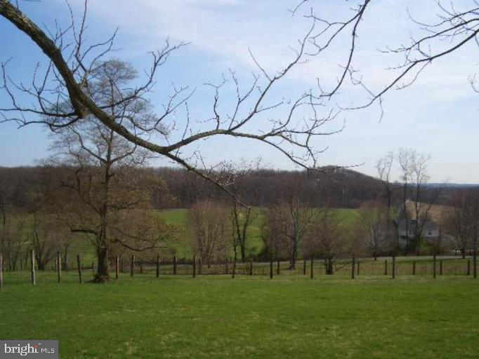 Outstanding southern pastoral and scenic views overlooking the Piney Hill Rd. Valley in beautiful Monkton, MD. This elevated 19.763ac. parcel of land offers the perfect location to build, is already cleared and is surrounded by majestic towering trees and forest, protected by Forest Conservation and Forest Buffer Easement Areas. The potential for an additional development right exists also!!