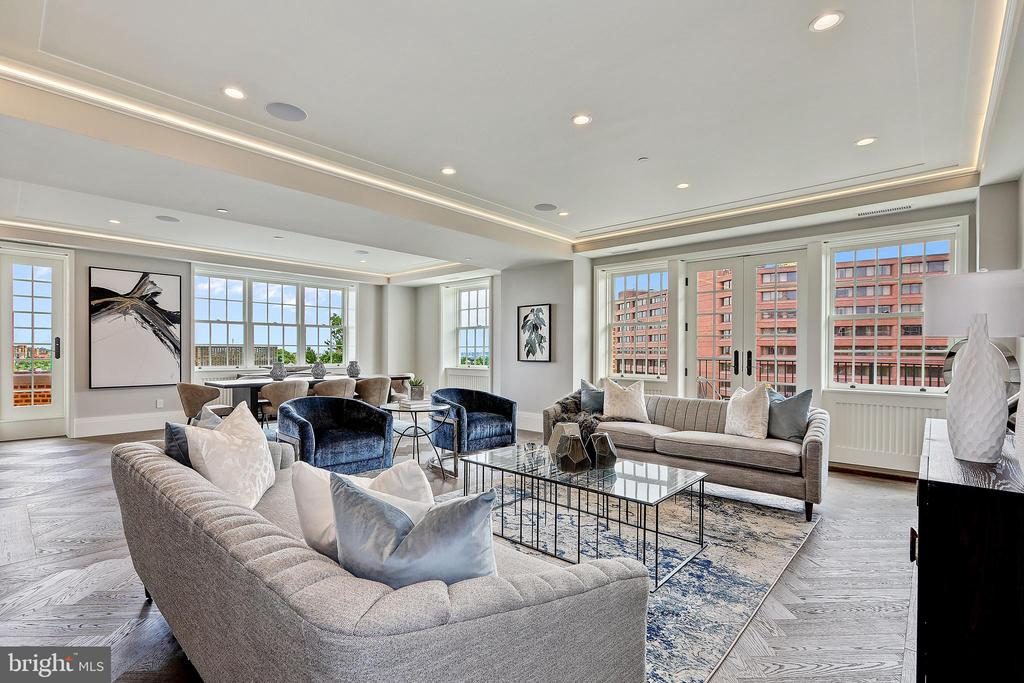 Welcome home to Wardman Tower, where luxury like this is timeless but it can't wait. Residence 6D is a well-appointed large flat adorned with a modern layout that leads through numerous gallery walls space from the 3 spacious private bedroom quarters with luxurious en-suite bathrooms into your spacious living and glorious entertaining spaces. This expansive home offers an eat-in kitchen with custom cabinetry by sustainable American brand Henrybuilt; Thermador appliances; Pentalquartz coastal gray countertops with Danby Royal marble backsplash. Throughout the entire residence are gleaming herringbone 6 inch wide oak Admonter wood flooring with custom millwork and generous closet space. The primary bathroom offers radiant heated floors; custom painted vanities with soft close cabinetry; custom designed stone tile flooring; Danby Royal tile on walls and countertops with nickel polished custom Watermark plumbing fixtures. The guest bathrooms will not disappoint with stone mosaic tile; glazed ceramic tiles on wet walls and Porcelanosa Krion solid surface countertops. Residence 6D includes 2 parking spaces and a storage closet. Numerous balconies complete this stately residence built by Henry Wardman in the 1920s and recently reimagined by Deborah Berke Partners. Each residence at Wardman Tower occupies part of a wing, radiating out from a central core making each residence unique. All 32 residences project toward the windows and the greenspace below landscaped by Michael Vergason Landscape Architects on over 2.5 acres of lush grass, trees, and gardens. Services include 24/7 concierge with white glove service; doorman; porter; on-site building engineer; unmatched fitness center with towel service; roof terrace with gas grill; two clubrooms; catering kitchen; landscaped garden terraces. Wardman Tower is pet friendly. This final period of sales is your last chance to purchase in this iconic luxury residence at the best possible terms.