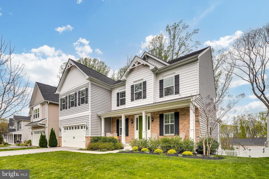 Spectacular-like new home located in coveted Broadneck School District. Located conveniently to Route 2 for easy access to Annapolis, Baltimore, and Washington. The local community is revered for its sports programs, music, and arts, YMCA is approximately one mile away, and many restaurants to choose from with three metropolitan markets surrounding it. The community, The Village at Stephens Woods, was built by K. Hovnanain and this home was completed in 2017. The thoughtful layout of the homes provides ample entertaining space. The community provides lots of social interaction with events such as egg hunts, costume parties, and progressive dinners. There is a walking trail to the Anne Arundel Community College, which is perfect for the Kids in College summer programs, walking, and sledding in the winter. The home is simply spectacular, has been meticulously maintained and you will feel like you are walking through a model home. Boasting an open concept that is perfect for entertaining, there is space for adults and children including a full finished basement with a large bar, plenty of onsite storage including a three-car tandem garage, and covered porch and deck with natural gas hook-up makes cooking fun and easy while viewing sunsets. Additional features of this incredible home include a gourmet kitchen with a 10' kitchen counter bar, spa shower, upgraded recessed lighting and fixtures throughout, seven zone irrigation, fenced backyard, and window coverings throughout. This is the perfectly finished home in a Blue Ribbon school district that you have been searching for!!!