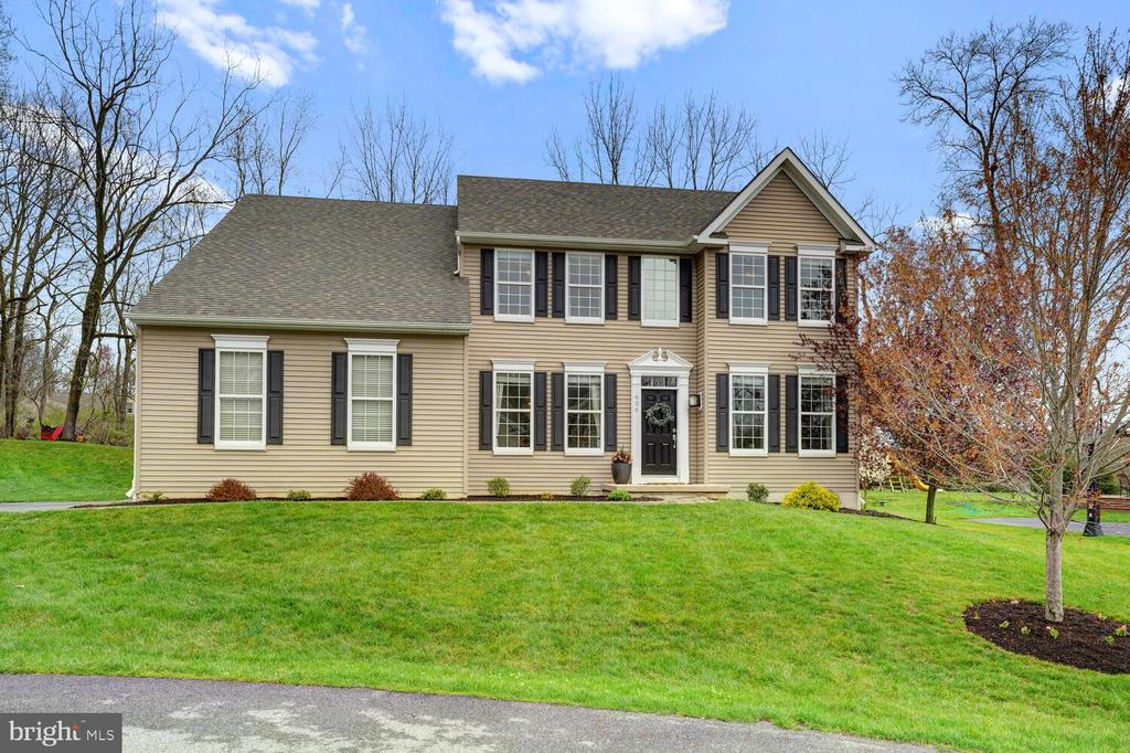 Welcome to 606 Mill Ct. located in the Brandywine Hill community in Wallace Twp.  This 2013 built Rouse Chamberlain Malvern Model is the most popular floor plan they offer. When you enter the two-story entrance, you will be struck by how open, sophisticated and bright the home is. There are gleaming hardwood floors leading to a large office or study and a good-sized formal dining room. The main living area has an open concept kitchen/ family room and a bonus room that is great as a playroom, 2nd office or zoom room. The eat in kitchen has new quartz countertops and quartz sink, marble backsplash, an upgraded induction cooktop, new stainless steel Bosch dishwasher, new microwave. There is plenty of seating around the island.  When you head to the second floor the master bedroom is well appointed. There is a large walk-in closet & a pretty bath with 2 sinks, soaking tub and stall shower. There are 3 additional good-sized rooms with ceiling fans, new carpets and well-designed closets. The lower level is a treat with a large space to play, relax or workout. There is another room with new carpet and ideal for additional workspace or hobby room. The outside has a large, maintenance free deck perfect for a spring night BBQ. The home is also equipped with a whole house generator. The association has its own hiking trails that are maintained by the HOA. Those trails can bring you to a public park with baseball fields and playgrounds, the elementary school and Springton Manor. Brandywine Creek with fishing, hiking, etc.  is across from the development. This home is elegant, bright and cheerful plus it's in a peaceful community.