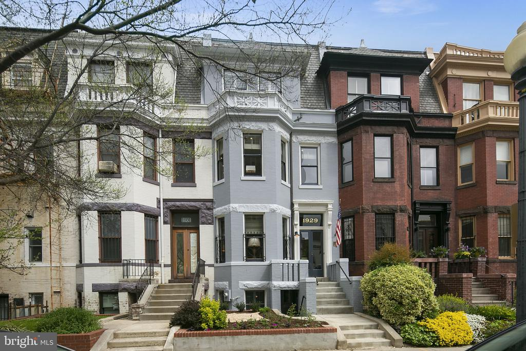 Offers, if any, due 4/20 at 10am.  Elegant Dupont Circle Victorian Home with original details and updated for today's living lifestyle. Designed by George S Cooper and built by John Nolan in 1885 - original details still remain throughout the home like the paneling on the first floor, fireplace mantles, and original hardwood floors throughout the top three floors.  The home's color palette and incredible woodwork is warm and inviting, yet the home has been thoughtfully updated through the years.  The southern exposure at the front and large top floor skylight offer beautiful light through many of the rooms and staircase.  A gorgeous brick and stone facade greets you on a highly walkable block of north Dupont.  Step into the vestibule before entering a lovely foyer with views of the grand staircase.  The living room is to your left and the parlor is just ahead - the perfect entertaining space. The large dining room easily seats 8-10, surrounded by incredible original wood trims and original fireplace.  The kitchen was renovated to the studs in 2015.  The inset kitchen cabinets were custom made with many user friendly features included.  A powder room is discretely and conveniently located off the kitchen.  The main level is outfitted with in-ceiling speakers pre-wired for Sonos or any amp.  2 car parking is just off the kitchen.  The second floor offers a fantastic den, office, and large bedroom suite.  The den might be your favorite room to relax in with a wall of built-in bookcases and cabinets. There is also a finished game closet. The large office on the second floor has two workspaces and ample office file space, plus two closets.  The rear bedroom suite easily accommodates a king bed with a bathroom featuring a glass stall shower, soaking tub, and washer/dryer.  The owner's suite encompasses the entire third floor with a large bedroom, dressing room with custom closets, pre-wired speakers, and a bathroom with another washer dryer.  The large deck off the third floor hall is great for evening dining and catching some sun on the weekends. The decking material is Brazilian Walnut Ipe, which is long lasting and durable.  Plenty of space for dining and lounging.  The basement unit was renovated in 2010 and has nearly 8' ceilings. While not currently a separate unit, it could be a great rental, den, au-pair or in-law suite. The 1 bedroom unit has three ways of egress. There is also 1 and a 1/2 bath in the basement. The kitchen has stainless appliances and granite countertops. There is a large storage room at the back.  Quick walking distance to all services. Close by to Glen's and multiple coffee shops and restaurants on Connecticut Avenue and 18th street. Everything is convenient. Two blocks walk to the DuPont Circle metro stop. A perfect urban location at the cusp of residential and commercial. The house is comfortable year round with two HVAC zones - installed in 2019 and 2015.  Currently zoned for Oyster-Adams Bilingual Elementary School.