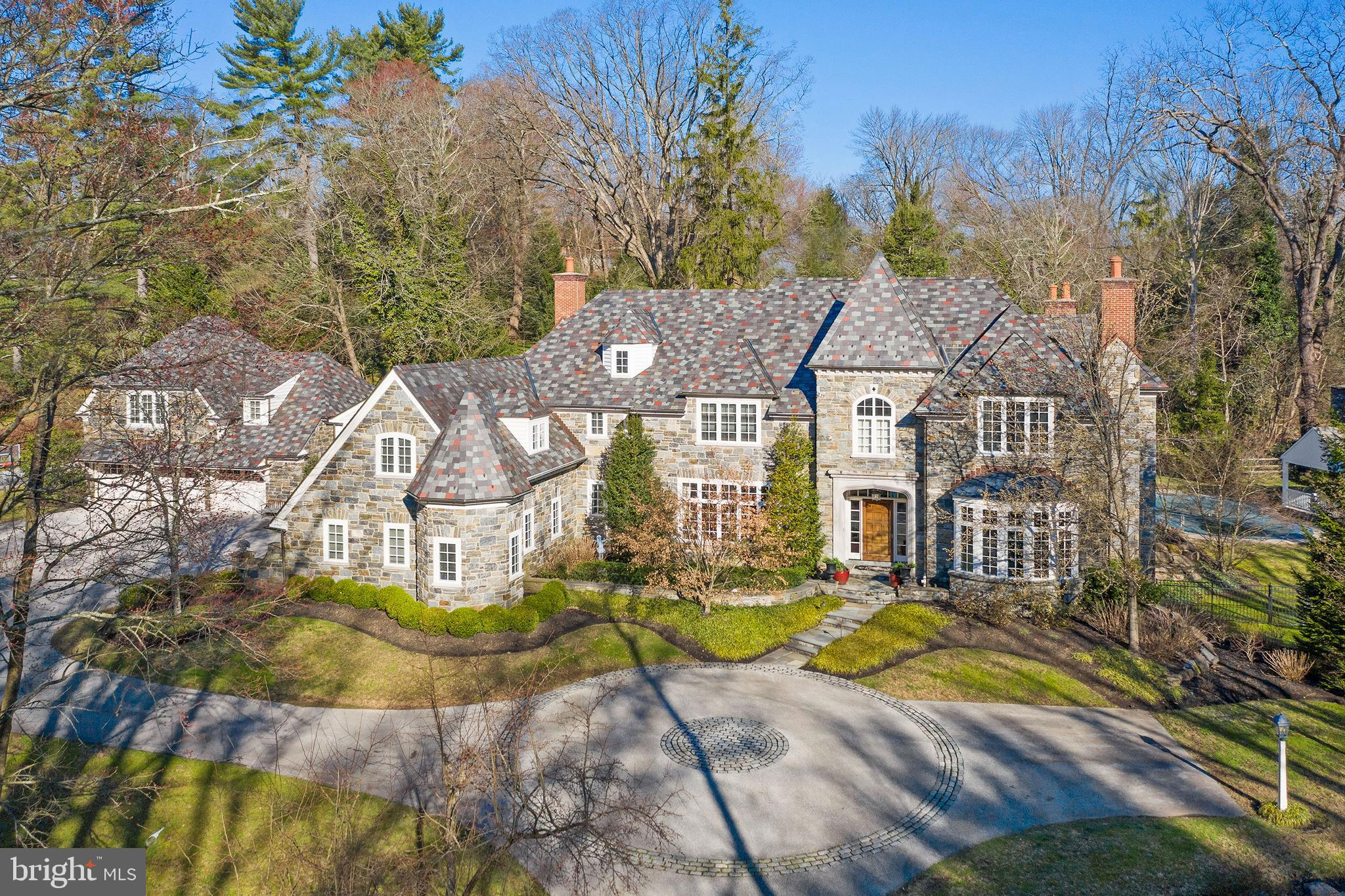 """Incredible opportunity to move right into this exquisitely crafted masterpiece, recently constructed by renowned Pohlig Builders and set on a breathtaking 2.3 acre lot with pool, Carriage House and Pool House in one of Villanova's most prestigious, highly coveted, """"walk to everything"""" locations. Extreme attention to architectural detail while carefully blending old world materials with every modern amenity and refinement is evident throughout this all stone residence, with stunning slate roof and matching secondary structures. Features include 10"""" ceilings throughout the first floor and 9"""" ceilings throughout the second floor, massive sun-filled windows with a wonderful open floor plan, beautiful moldings, casements and millwork, wide- plank hand carved oak floors, gracious room sizes throughout, a fabulous custom Gourmet Kitchen with top of the line professional appliances,  First Floor private In-Law Suite with full Kitchen and Bathroom, Luxurious Master Suite with His and Hers marble Baths, 4 additional spacious second floor Bedrooms with custom En-Suite Baths, an expansive beautifully finished Lower Level and incredible separate Carriage House Guest Apartment with vintage Kitchen and Full Bathroom, Living Room with fireplace and cozy Bedroom.  This rare treasure offers serene privacy while being close to renowned schools, shopping, restaurants, trains, all major commuting routes and just minutes from Philadelphia International Airport and Center City Philadelphia.  LOW TAXES:  Walk to The Radnor Trail! LOW TAXES!!"""