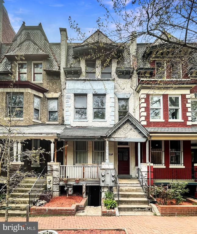 List price to be opening bid.  Online Auction Only! Bidding begins May 15th & ends Thursday, May 20, 2021 @ 1:00pm.  Location: Unbeatable location on picturesque block next to the Anna J Cooper Circle in the Ledroit Park Neighborhood of NW Washington, D.C.  4 short blocks to the shaw metro stations and the hottest restaurants and nightlife the city has to offer.  Improvements: Townhome with 3,300 +/- sq. ft. of living space with many wonderful improvements. In need of renovation or redevelopment.  The  property is ideal for potential conversion into condominium units or a return to former glory as in-town manse in one of city's most desirable locations. Square 3089 Lot 0060. Lot size of 1,653 +/- sq. ft. 3,302 +/- sq. ft. of living area according to tax record.  Zoned RF-1.  Property Description: 1st floor: Large entrance foyer, living room, eat-in kitchen, dining room and powder room. 2nd floor: Large open floor plan with a full bathroom and bedroom. 3rd floor: Configured as an in-law suite with eat in kitchen, bathroom and bedroom. Lower Level: Configured as a residential unit with front and rear entrances, family room, bedroom, utility room and eat in kitchen. Rear Yard: Private patio with large open area with landscaping, custom brick work, stucco and enclosed porch. Additional Features: Wood floors throughout 2nd level, Fireplace on first level, Custom metal gates on front entrance of English Basement and rear patio walk-up, Numerous original architectural details such as wood paneling, exposed brick and tile, Many windows have been replaced, English basement entryway has been dug providing a large entrance.  Utilities: Baseboard electric heating for 2nd and 3rd floors. The first level and lower level are believed to be heated by a gas fired forced hot air furnace. There are four electric meters. The property has public water and sewer. There is 1 gas meter.  Please call for private appointments.