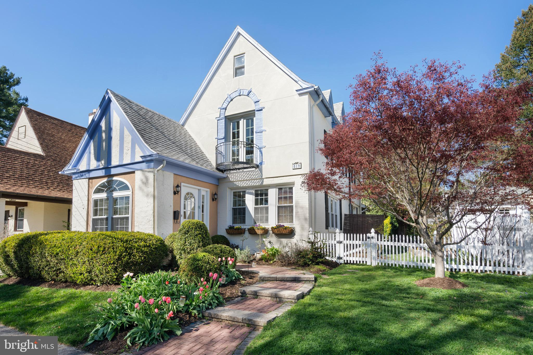 SUN-DRENCHED & MOVE-IN-READY MAIN LINE COLONIAL with 1 Car Garage in a VERY RARE & MOST DESIRABLE WALK TO EVERYTHING LOCATION!!! Minutes to the center of Ardmore & Narberth (R-5 Train, Apple, Starbucks, Movie Theater, Library, Playground, Restaurants and Boutiques), in a SIDEWALK NEIGHBORHOOD and less than 1 BLOCK to the highly acclaimed Lower Merion High School -- nationally recognized as a Blue Ribbon School of Excellence!   This 5-6 bedroom, 3 & 1/2 bath home offers character and details of a Bygone Era w/ FRESH, designer sourced finishes, Tasteful Modern Updates, OPEN CONCEPT FLOOR PLAN & MOVE-IN CONDITION. The gracious vestibule entrance leads to the Large Living Room w/ wood burning fireplace, built-in bookshelves,  & huge walls of windows on 2 exposures OPEN to the Large Dining Room w/Wall of Windows & Updated Kitchen w/ Vintage White Maple Cabinetry, Honed Absolute Granite Countertops, Carrara Marble Subway Tiled Backsplash, Stainless Appliances including 4 burner range w/ Stainless Hood, French Door Refrigerator, Deep Sink w/ sprayer, Large Built-In Storage Pantry &Doorto the SERENE 3 Season Sunroom w/ Vaulted Ceiling & FULLY FENCED YARD (Perfect for BBQ's, Outdoor Entertaining, Dining Al Fresco, Campfires & WONDERFUL MEMORIES!!!) -- the indoor/outdoor flow from both the Kitchen and Dining Room flow nicely to the side and year yards - circular flow at its best! The gracious carved staircase w/ windowed landing accesses the second floor offering 4 bedrooms including the Owners Suite bathed in natural sunlight and offering 4 Large Closets & Juliet Balcony accessing the Full Updated Hall Bath w/ Marble Tiled Floor, Vintage Painted Vanity, Beadboard and Tub Shower - Styled to PERFECTION!!! The 3rd floor offers Br#5 w/ Skylight & Ensuite Full Hall Bath w/ Original Claw Foot Tub, Large Storage Room and Bedroom #6 w/ Skylight (currently used as home office). The Finished Lower Level offers Amazing Additional Finished Living Space including Play Room, FULL Bath w/ 