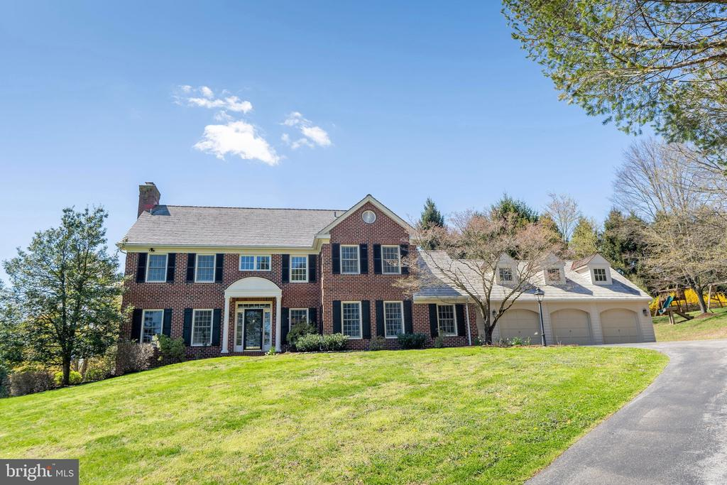 Welcome to 1542 Yellow Springs Road in Chester Springs.  Set back at the end of the driveway and built at the crest of a hill, this Zimmerman designed, brick Williamsburg Colonial built by Diament homes has been updated and will provide you breathtaking panoramic views of the rolling Chester County countryside year-round.      It's hard to list all of the indoor features in this stunning home.  Enter into a two story, all hardwood, foyer to see a grand curved staircase, the formal dining room and cozy living room with fireplace.  Just off of the living room, enjoy the private library with dry bar, built with cherry wood containing custom built-ins as well.  The modern open floor plan kitchen contains luxury high-end appliances, granite countertops, freshly painted cabinets, and a large kitchen island that flows into the impressive large eat-kitchen area.  Nestled off of the kitchen is the light filled family room containing a fireplace with vaulted ceilings, ceiling fan, and recessed lighting.  A large mudroom, spacious panty, and a half bathroom balance out the first floor that has a private side entrance.  The second floor offers an impeccable sprawling master suite that includes a sitting area, a newly renovated master bathroom with jacuzzi tub, oversized shower, and a large walk in closet.  In addition to the master suite there are three bedrooms; a bedroom with private bath, a large bedroom suite over the garage at the end of a private hallway, and a bedroom across from the spacious hall bathroom.  Don't miss the newly finished basement which provides a full bathroom, radiant floor heat, plans and plumbing for a wet bar, a fireplace, with a walk out sliding glass door to the impressive two-level patio.  Enjoy the private back yard, a sitting area with fireplace and a separate dining area.      The owner has impeccably maintained this property.  The property has new all-clad Marvin windows and doors, a new roof installed in 2018, fresh interior paint, recently p