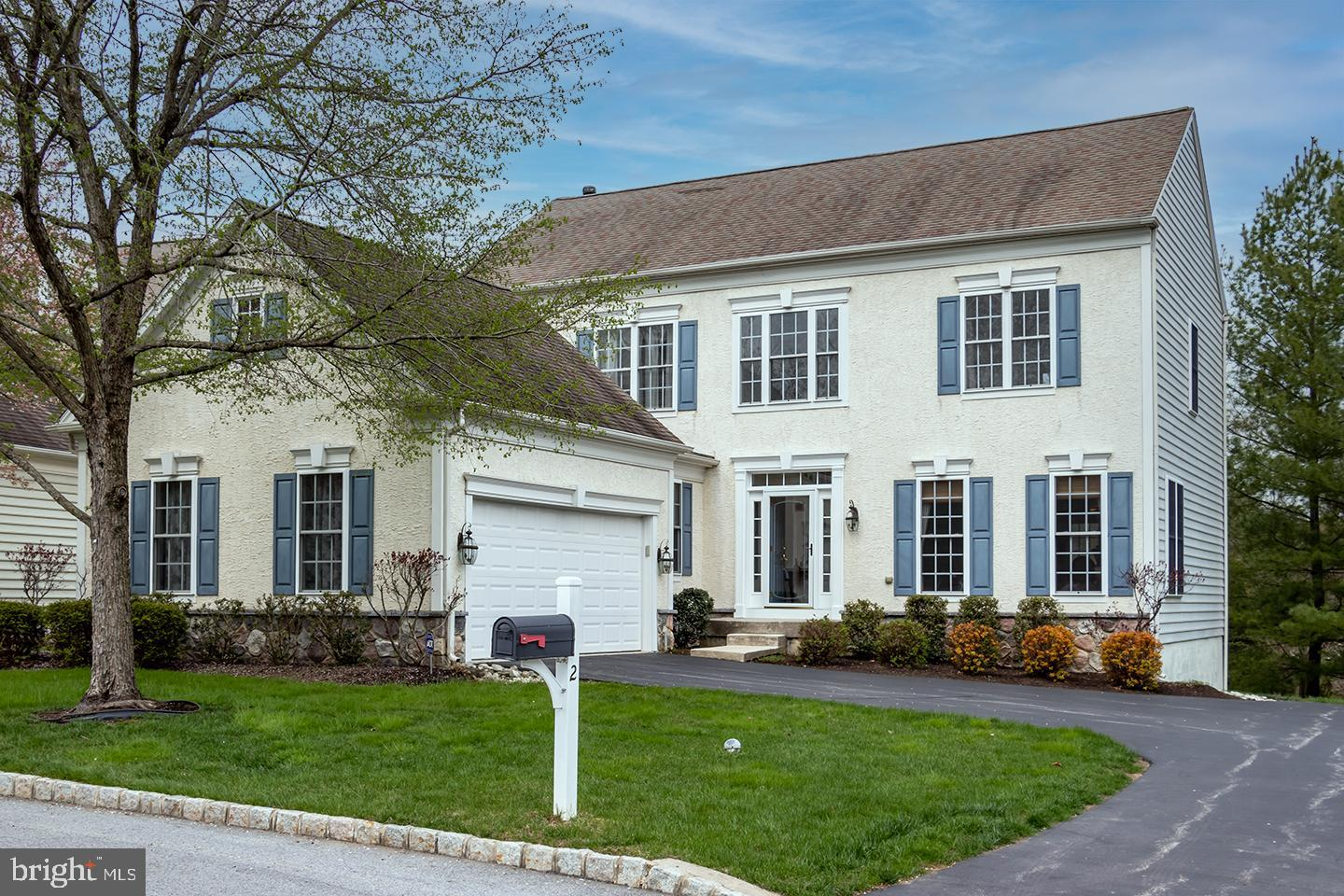 """Back on the market after a buyer fall thru, this stately 4 BR 3/1 BA home in desirable Hunter's Run offers a soaring foyer, open floor plan, miles of hardwood floors, custom trim work, gorgeous cabinetry, corian countertops, and stainless appliances kitchen, huge primary suite, first floor home office and laundry, finished walkout basement that could easily be an in-law or au pair suite, large deck with private rear yard, AND with lawn and landscaping included in the HOA! You are welcomed in with well-maintained mature landscaping to the soaring foyer with dramatic staircase and beautiful hardwood floors which sets the tone for an airy open concept floor plan.  Formal living and dining rooms flank the foyer and feature fabulous column detail and generous moldings - crown, chair rail, and wainscoting – which speaks to the craftsmanship throughout the house.  A large family room area with cozy gas fireplace w/custom mantle and trim detail above, recessed lighting, custom transom window to the office, all add to an open, comfortable vibe, perfect for family or entertaining.  The chef's kitchen has a large island with seating, 42"""" cabinets with crown molding and gold tone knobs, corian counter tops, stainless steel appliances (double wall oven with convection, gas cooktop, built-in microwave, dishwasher), custom tile backsplash, and sliding door to the deck.  The first floor also features an office with custom mouldings, powder room, garage entry, and multiple closets. The second level features a huge private owner's suite sanctuary with tray ceiling, ceiling fan, and tiled full bath (separate vanities, soaking garden tub, glass stall shower, and linen closet), and a walk in dual sided closet with attic access.  There are 2 additional large bedrooms that share a Jack and Jill full bathroom. The partially finished walk out basement provides a possible in-law or au pair suite, with lots of bright windows, a large bedroom with tiled full bath, a large living area with gas """