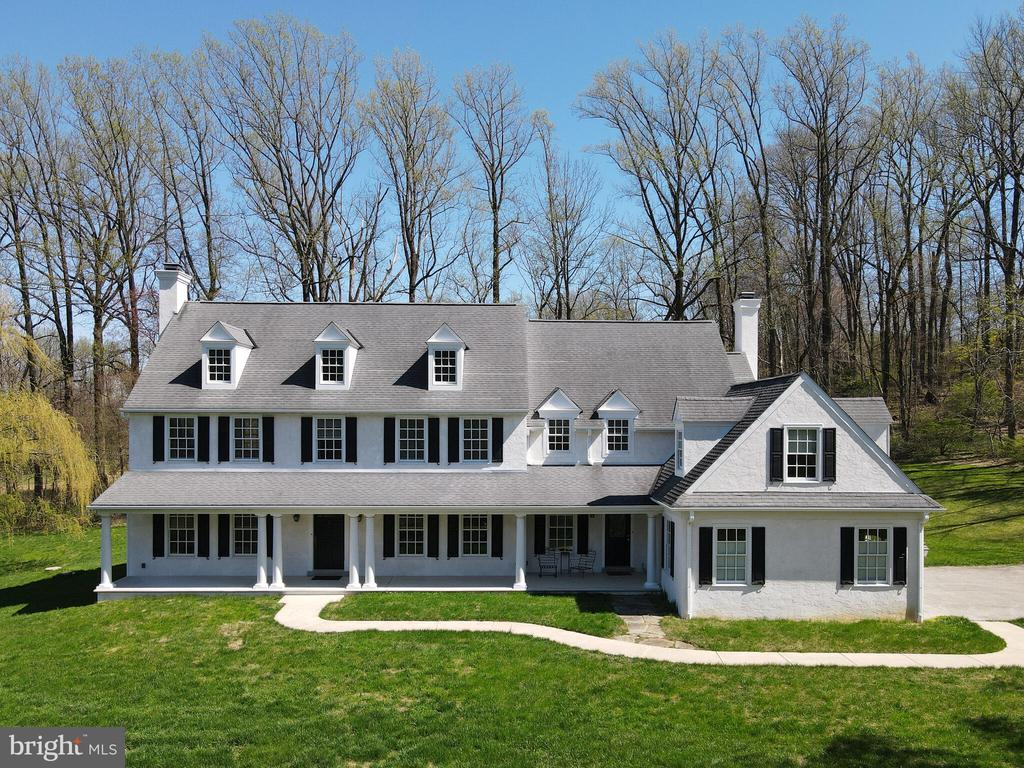 This custom built home on 7.9 pastoral acres includes a large all-stone barn (c. 1830).  The extensive road frontage, elevation and long overhead porch of the home allows a panoramic view in rural Birchrunville.  In addition to its own park-like setting - the local stocked fly fishing streams, trails, bike paths, walking parks and cafe are only a short distance allowing endless possibilities for outdoor activity.  The home was well built by a Chester County custom builder with attention to detail, tasteful millwork, a stunning entrance hall and 9ft. ceilings that allow 8ft. French doors in the main hallway as well as in the kitchen and family room.  A study/office area provides a cozy and bright place for work or hobby.  Fireplaces on either end of the home add warmth and charm on a country winter evening and a bright kitchen leads to a comfortable family room with the fireplace banked by large French doors that give access to patio and lawn all bordered by mature trees.  Nature is visible from every room through large upgraded windows in this lovely country setting.  Two stairways provide separate access to the second floor bedrooms and laundry.  There is a large bright master bedroom and bath as well as two additional spacious bedrooms and full bath.  A partially finished fourth bedroom can be entered from a landing on the rear stairway.  Custom hardwood floors predominate with selected rooms being carpeted.  The very large and rare all stone barn is just a short distance away off the main driveway lending an historic feeling of days past and affords an owner the opportunity for horses and a multitude of other purposes. Some more special features of this home are: close to Village of Kimberton, Kimberton Waldorf School, and the Montgomery School. Loads of Parking-even horse trailer parking - and you can pasture horses on this property- what a perfect property  for that special buyer looking for a Park like setting with a Home and Barn too.