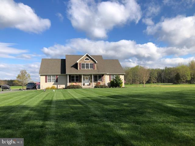 Your piece of paradise awaits in this beautiful custom built home situated in country setting, backing to Delaware State owned open land but just minutes away from Middletown.
