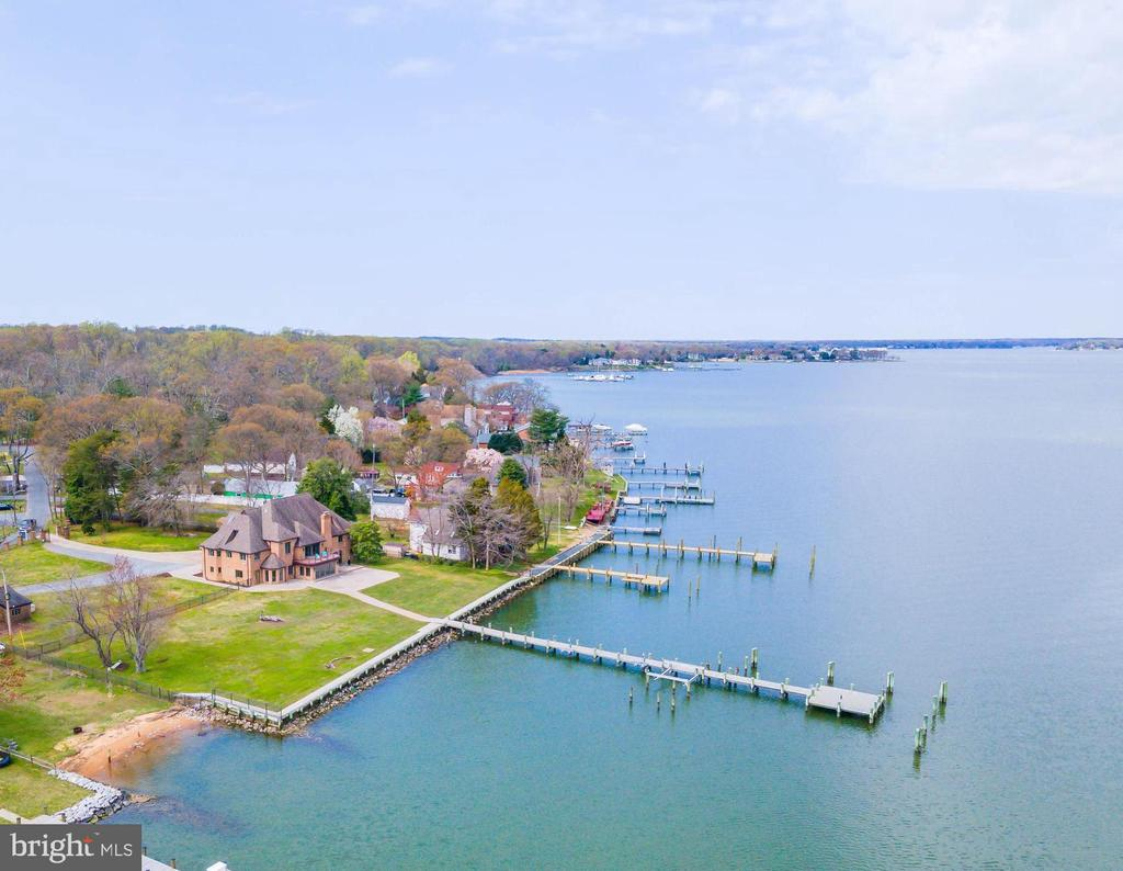 """Escape to """"Tusculum"""" a glorious waterfront estate on the shores of the Magothy.  This striking, all brick waterfront manor sits on a flat 1.2-acre double lot with 217 feet of water frontage and plenty of room for an in-ground pool.  Live the waterfront lifestyle and entertain inside and out from this exquisite retreat with breathtaking views of the Magothy River, Gibson Island and the Chesapeake Bay.  Premium quality, low-maintenance materials were used throughout the elegant, 7,000 sqft, custom home boasting 7 bedrooms, 6 bathrooms and a light-filled, 2-story entrance with grand staircase and soaring ceilings.  Other fine features include: 3-zone Geo-thermal HVAC, 75KW Generator, 3-car garage, circular driveway and 217 ft of bulkhead/stone revetment.  The expansive pier complex is the perfect launching point for the boating enthusiast, providing quick access by boat to the Chesapeake Bay.  The sale includes a charming guest cottage, which sits on the adjacent waterfront property (986 Forest Drive - Tax id# 020374990007934).  The Shore Acres community beach, picnic area and boat ramp are just one block away, and the property is located in the highly coveted Broadneck school district.  It's the perfect location to quickly access downtown Annapolis for shopping and dining or jump on Rt. 50 to get back to Washington, DC.  If you're looking for a fabulous property in a great neighborhood setting with the complete waterfront package, this is absolutely the best value on the market!   To explore the property without leaving your home, be sure to view the HD Video Tour: https://youtu.be/xE4PETItZQg"""