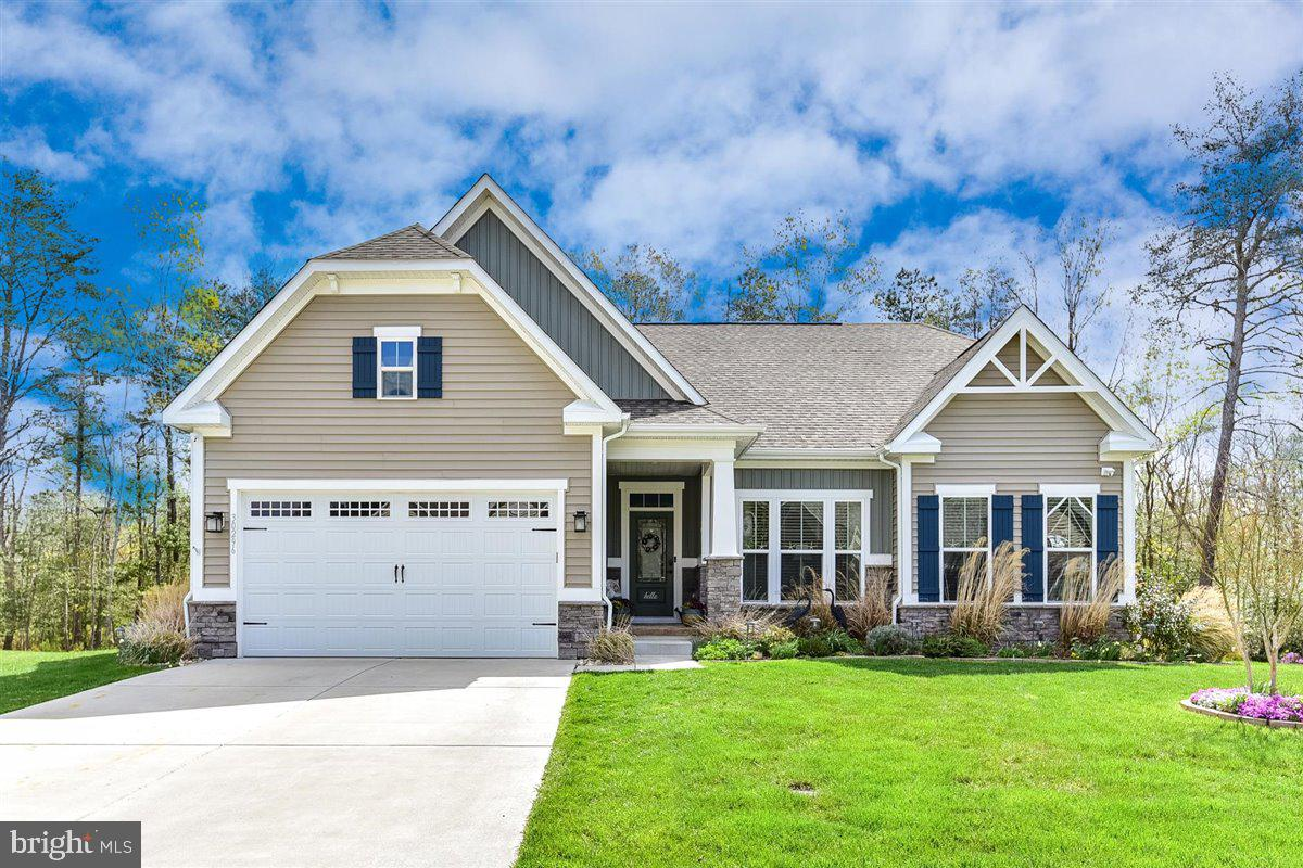 Move In ready- 3 Bedroom, 3 bathroom w/basement loaded with all the options! Built in 2017 on a premium lot that backs to private woods and adjacent to community pond and common area. This Carolina Place Model has a large front porch, entry foyer with a private office and built in book shelves. The main level has a mudroom off the 2 car garage, laundry with washer & dryer and extra storage cabinets. Open floor plan with 9' ceilings, living room with gas fireplace, well equipped gourmet kitchen with gas cooktop, double wall oven, soft close glazed cabinets, Breakfast bar island with seating for four, SS appliances, and granite countertops. Dining area off kitchen that overlooks private back yard also screened in porch as well. One guest bedroom and full bathroom  with tub/shower. First floor master bedroom has his and hers closets, private access to back porch, master bath with his and hers sinks and walk in shower, also a private water closet. Second floor addition has a 3rd bedroom and it's own full bathroom.  The full basement is 50% finished living space and the rest offers plenty of storage. The home owners also added a whole home generator that is very quiet and efficient and has come in handy over the years as well as a separate well for the front and rear irrigation system. Garage has climate control heat and air unit for your workshop or car collector. More information, photos and virtual tour to come!
