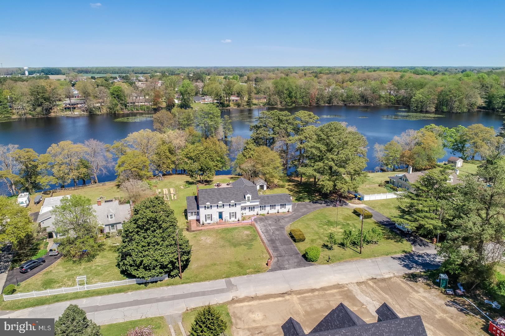 """Start living your Waterfront Dreams with this 1.07 acre property that has approximately 250 feet on Records Pond in the historic Town of Laurel.  This completely remodeled spacious home is the perfect blend of Old and New with the Charm of Old Colonial Style and the Modern Updates of a New Home. Although it was built around 1943, it has been recently rebuilt """"from the studs"""" and completely renovated ... New Custom-Designed Kitchen Cabinets, Quartz Countertops, all New Drywall throughout, Electric Upgraded to 200 amp, New Plumbing throughout, HVAC has 2-Zone Service (at 1st & 2nd Floors), High Efficiency Windows with Transferrable Lifetime Warranty, New Roof in 2019. Plus Hardwood, Ceramic Tile & Brick Floors throughout. Ask your Real Estate Agent to print out the full listing of Improvements/Custom Features. The Great Room in back provides magnificent views of the Backyard, Gardens and Pond. Relax in the 2nd floor Master Suite's Soaking Tub overlooking """"Laurel Lake"""".  Fisherman's Delight!  Fish in your own backyard in stocked Record's Pond! Don't risk losing this once in a lifetime opportunity! Schedule your Private Tour Today!"""