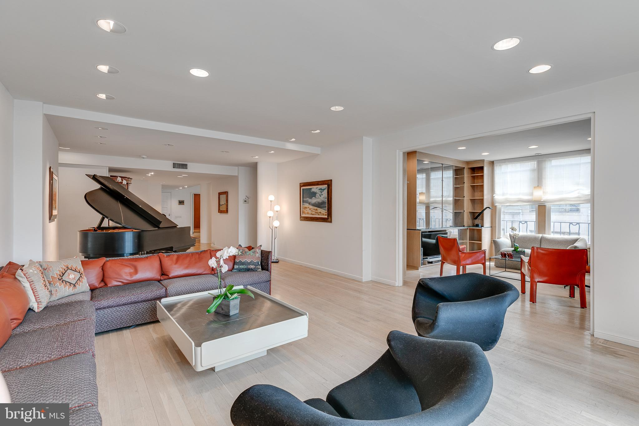 This bright, corner three bedroom and three bathroom home at The Rittenhouse Plaza has all the layout and design flexibility a new buyer could only hope for. The gracious entry foyer leads to an oversized living room with three exposures providing open magnificent Rittenhouse Square Park views with great light all day long. There are bleached oak floors and high ceilings throughout. The large living room is adjacent to a windowed library and partially separate dining room, allowing for both intimate entertaining as well as larger parties. The functional eat-in kitchen offers ample counter space and easy flow. The new owner also has the option of making these rooms into one spectacular great room for a more modern space.  The master bedroom suite has additional closet space as well as a generous en-suite master bath. There are two additional well-proportioned bedrooms both with en-suite baths. As an added bonus, this wing has a functional windowed, dual workspace/home office. The third bathroom serves wonderfully as a guest powder room and can also double as a dedicated bath if the added privacy is preferred. There is an abundance of storage and closet space throughout.  The Rittenhouse Plaza, 1901 Walnut Street, is a full-service coop with a full-time doorman. The building is situated in the perfect location on Rittenhouse Square surrounded by the best restaurants, chic boutique shopping, and all modes of transportation for your convenience. There is a 1% flip tax paid by the purchaser. The building allows pets with restrictions.