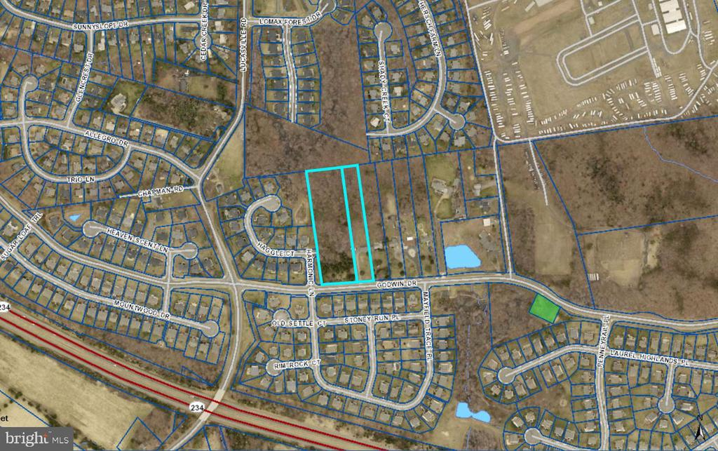 Subject property has potential for 16-20 lots. The subject parcels are left over from the nearby developments which were developed with single family homes from 1980 to 2013 on quarter acre lots in Hailees Grove, Country Roads, Hersch Farm, Smith Pond, Mayfair, and Mayfield Trace subdivisions.  As the subject is adjoined on the south and west by R4 zoning and with R4C zoning on the north, it seems reasonable to assume that the County would look favorably on rezoning the subject to R4.  R4 allows low-to-moderate density residential uses at approximately four dwelling units per acre.  The minimum lot size is 10,000 SF with minimum lot width of 70' (100' for corner lots) with open space of 60% of the lot.  Front, rear and side setbacks are 30', 25' and 10', respectively.  The reader is referred to the Prince William County on-line residential zoning ordinances for more details. The subject's can be economically developed under these restrictions.  With the 5.2841 acre size, the subject could potentially developed with as many as 20 homes under the R-4 zoning.  However due to the necessity of providing interior road access, drainage ponds, setbacks, etc. the probable lot yield might be closer to 16 lots.   Two lots totaling 5.2841 acres for sale in Manassas.  10449 Godwin Drive (7794-37-9831) is 3.6486 acres. 10551 Godwin Drive (7794-47-1430) is 1.6355 acres with a 3 bedroom, 2.5 bathroom, brick front house on site. Both lots are zoned A-1 (Agricultural)  in Prince William County.  Located on the corner of Godwin and Harmonic Lane.  Lots have easy access to Rt-234 and Rt-28.