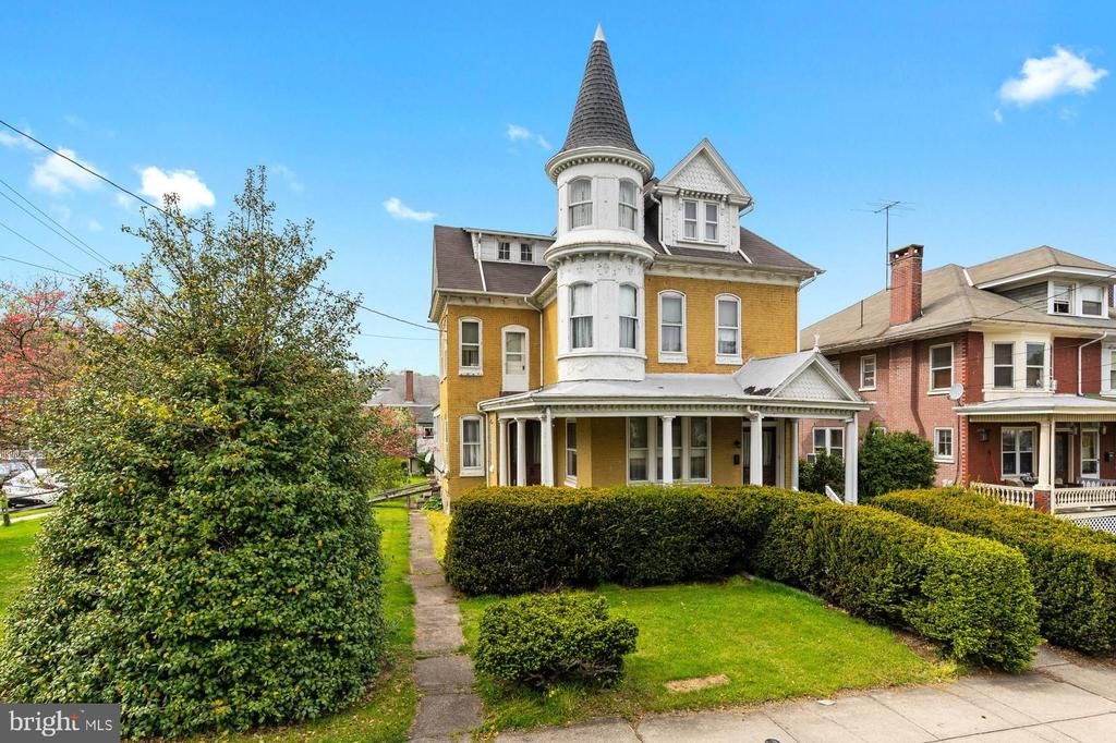 A one of a kind grand Victorian in the heart of Boyertown. Located just a block down from the State Theatre and nestled on an oversized corner lot. This home exudes all the original characteristics of 19th century opulence. The handcrafted wood finishes spare no expense and will certainly wow you, just as it did when the home was built over a century ago. The large windows and high ceilings give you an air of grandeur, yet the warmth and comfort of home. The dazzling two story corner turret welcomes you with its whimsical charm and statues atop the elevated wrap-around porch. This three story home is over 3,500 sq ft with 6 bedrooms and 2.5 baths. All the rooms are sizable, including a living room, family room, dining room, eat-in kitchen, and even a second kitchen on the third floor.  Outside there is plenty of room for the family to play. You will also find ample parking and a two car garage with a second floor workshop. The location is perfect! You are walking distance from all the restaurants, shops, parks, schools, and recreation that Boyertown has to offer. You must come see this gem from from the time of elegance. You do not find this amount of detail and top notch craftmanship in homes anymore. This could be your one of a kind...