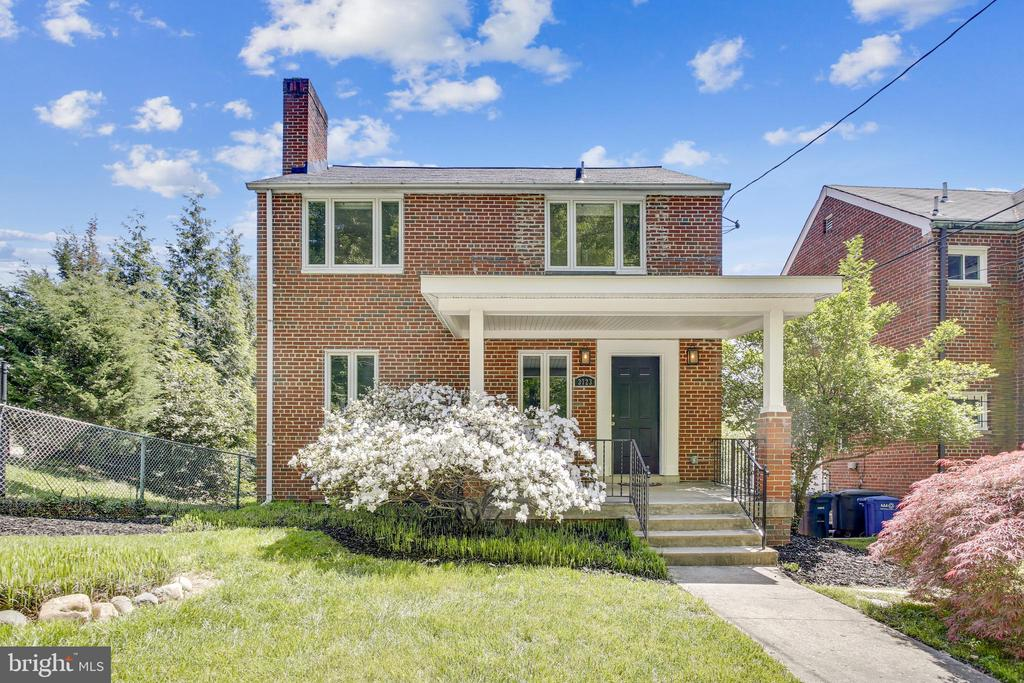 Discover peaceful living with this 3bd/2br brick gem in Brookland! Hardwood floors and large windows means PLENTY of natural light. Features include living room with brick fireplace, large eat-in kitchen, Central AC,  finished basement, 2-car garage, and sweeping backyard. Master bedroom comes with en-suite bathroom with dual sinks. Yard is Huge - Includes 2 lots to total  10,230 sq/ft with plans for large addition.  Walk to Franciscan Monastery Gardens, Monroe Street Market, 12th Street bars and restaurants, and the Brookland-CUA Metro station. OPEN HOUSE SUN 1-4
