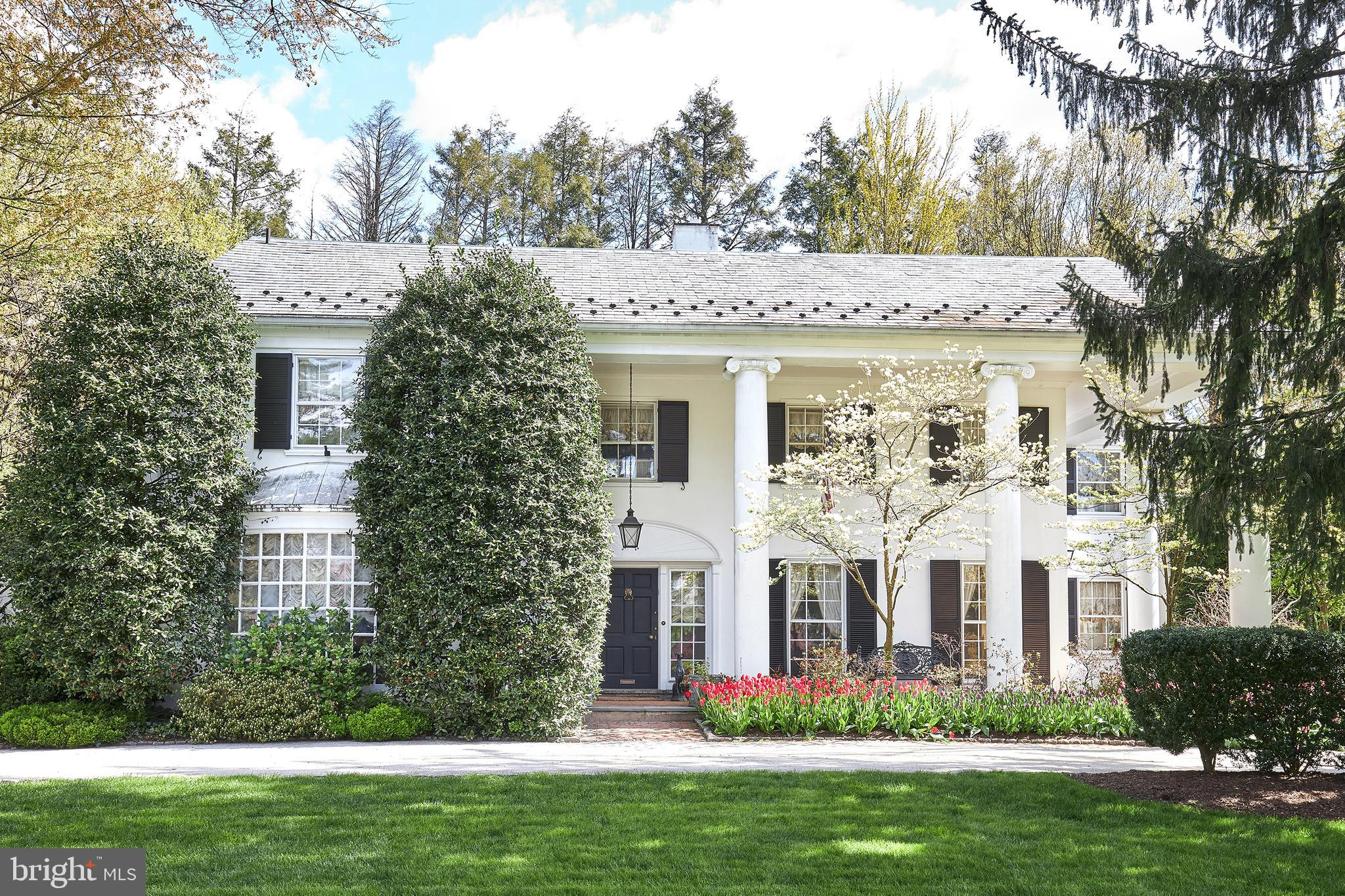 Early 2022 settlement preferred.  Perfectly set on a breathtaking 1.3 acre flat lot on one of Wynnewood s most coveted tree lined streets, this stunning estate awaits its next stewards, after being exquisitely renovated, expanded and improved by the same family for over 50 years. Originally designed by famed society decorator Dorothy Draper, this glamorous home offers spaces that cater to a fabulous, everyday family lifestyle as well as providing for effortless entertaining. Every detail and design element have been impeccably executed and highlights include a dramatic front to back black and white marble entrance foyer with padded and upholstered Scalamandre damask walls, gracious sun-filled Living and Dining Rooms with 9  ceilings and carved crown moldings, two separate beautifully appointed home offices with custom built-ins and bookcases, fully mirrored formal powder room replicating Coco Chanel s Paris apartment, breathtaking Family Room addition with floor to ceiling windows and French doors overlooking the private grounds, classic white Kitchen, Breakfast Room and additional sitting room which could easily accommodate a large eat-in Gourmet Kitchen, luxurious Master Bedroom Suite with his and hers baths and Dressing Rooms with extensive custom-crafted built-ins, two additional Bedrooms on the second floor, one of which is now used as a stunning office with walnut book cases and crown moldings, and a bright, private third floor bedroom suite with classic white-tiled bathroom. Mature landscaped grounds with stunning pool, pool house and existing footprint of a har-tru tennis court with rare outdoor lighting and a putting green complete this all inclusive property. This timeless treasure offers a serene setting while being within walking distance to trains, dining, shopping, renowned hospitals houses of worship, and just minutes away from the finest schools, universities, Center City Philadelphia, Philadelphia International Airport and 95 minutes to New York Cit