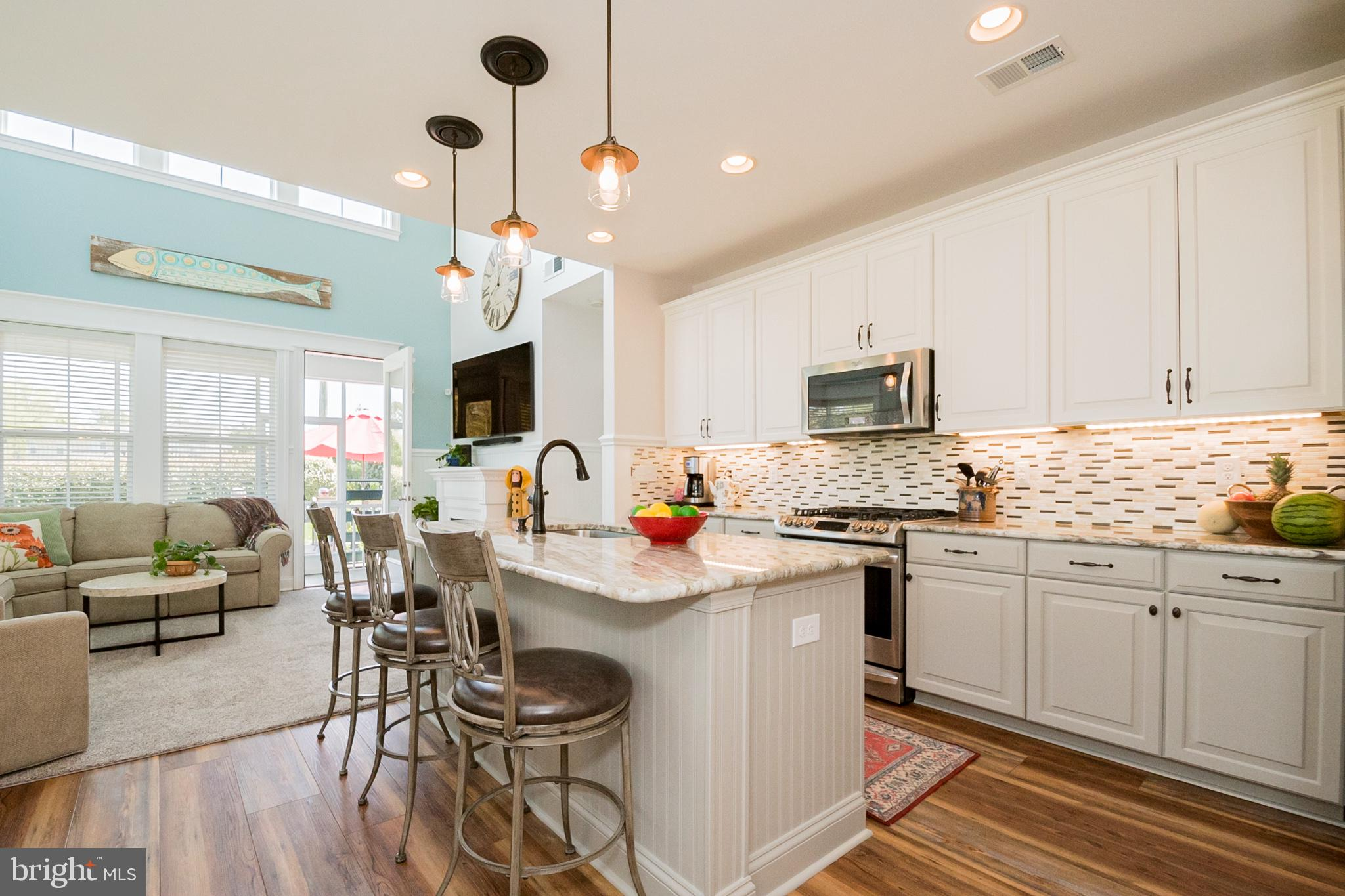 """Better than Brand New! This incredible Coastal Style End Unit Townhome has improvements and fine finishes not even offered as builder upgrades. Sellers spared no expense in updates to flooring, countertops, appliances, HVAC, and hardscaping with outdoor fire pit. Enjoy wainscoting throughout, shiplap accent wall, window/door trim work, closet built-ins, remote motorized window shades, beautiful custom shower in Owner's Bath, Epoxy Garage Floor and so much more.  Kitchen features 42"""" cabinets, granite countertops, stainless steel appliances including gas range, backsplash and under-cabinet lighting. Updated HVAC to Dual Zone Bryant 2 stage 96% Energy Efficient Heat and 2 stage 16 SEER A/C plus added U/V Light for cleaner air circulation. Enjoy resort amenities at Bishop's Landing including large 10,000 sqft state of the art community clubhouse with large fitness center, multiple community pools (Including Olympic-Size swimming pool), tennis/pickleball courts, walking/jogging paths/trails, dog park, community fishing ponds, and community beach shuttle. This home is an absolute Must See!"""