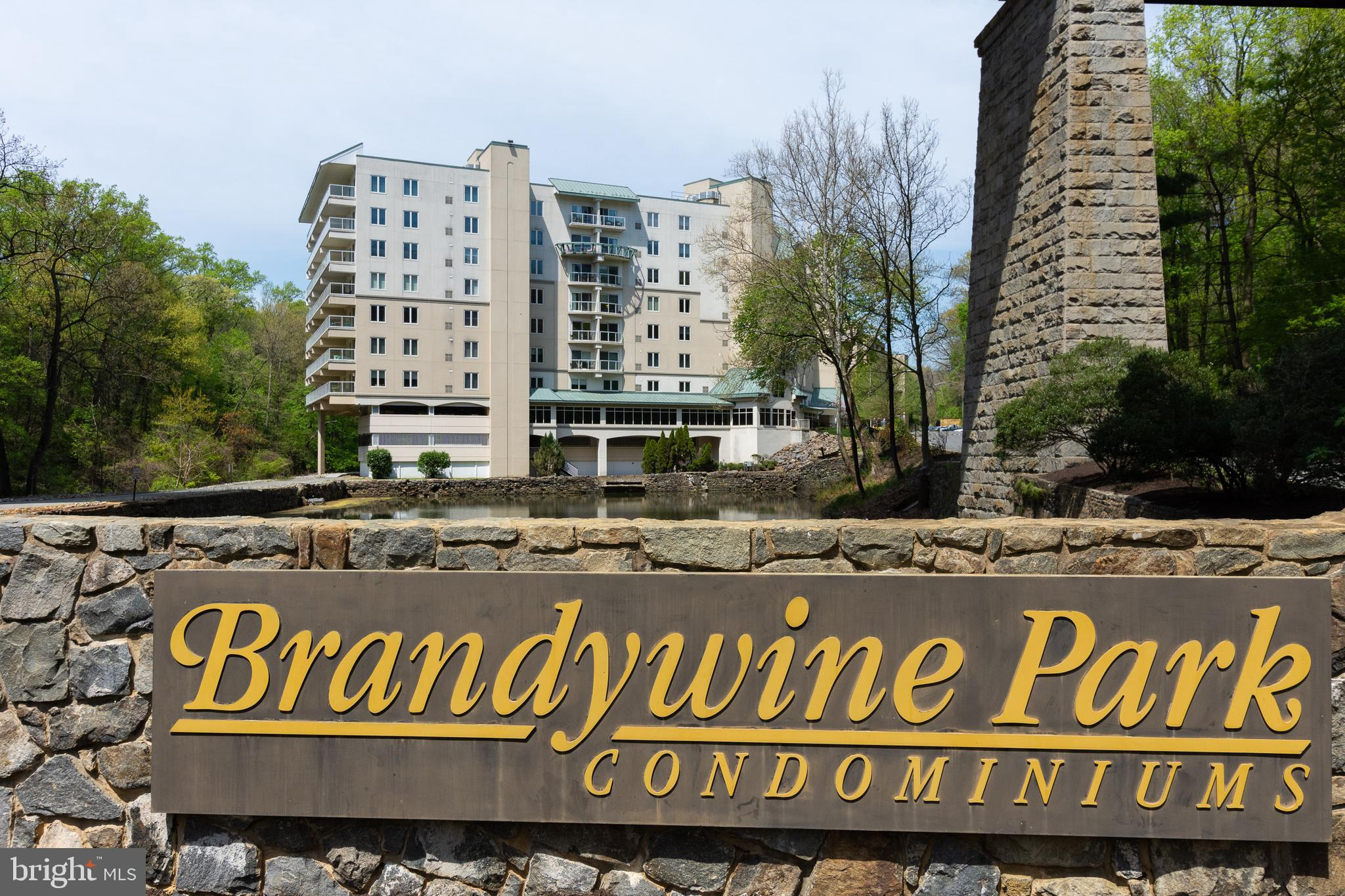Rare opportunity in the Old Mill of Brandywine Park Condominiums. This 3rd floor 3 bedroom, 3 bath, plus a den condo has an open concept floor plan, high ceilings, and abundance of natural light entering through a dramatic, oversized skylight in the raised ceiling. Breath taking views with floor to ceiling windows on the river side, make this unit even more exceptional. Hardwood floors flow through the main living areas of the kitchen, living room, dining room, and den. The den features built-ins for home office organization. Well equipped kitchen with abundant white cabinets and granite counters. Spacious master suite with walk-in closet, full bathroom, and window seats affording beautiful views. There are two additional bedrooms and baths. One of the guest baths is adjacent to the primary suite and has a pocket door to the primary suite creating an extension of the primary bath for when you aren't hosting company and prefer to allow each owner to have their own bath. Laundry is cleverly tucked away in the hall, but allows ample room to work. Enjoy river and park views from the private balcony. Brandywine Park is a gated community with 24 hour concierge and security.  Two designated parking spots, one in the covered garage,  and ample guest parking. Community amenities include fitness center, community room, in-ground pool, and patio space with grilling area. Situated on the banks of the Brandywine River, Brandywine Park condominiums affords gorgeous views of the river and Brandywine Park throughout all seasons. Enjoy a walk or jog through the park to witness the blooming of the roses in the rose garden, stroll through the zoo, or watch the water dance in the newly renovated fountain. Don't miss your opportunity to live in a one of a kind penthouse located just outside Wilmington city limits with all the convenience of city living, but not the city taxes.