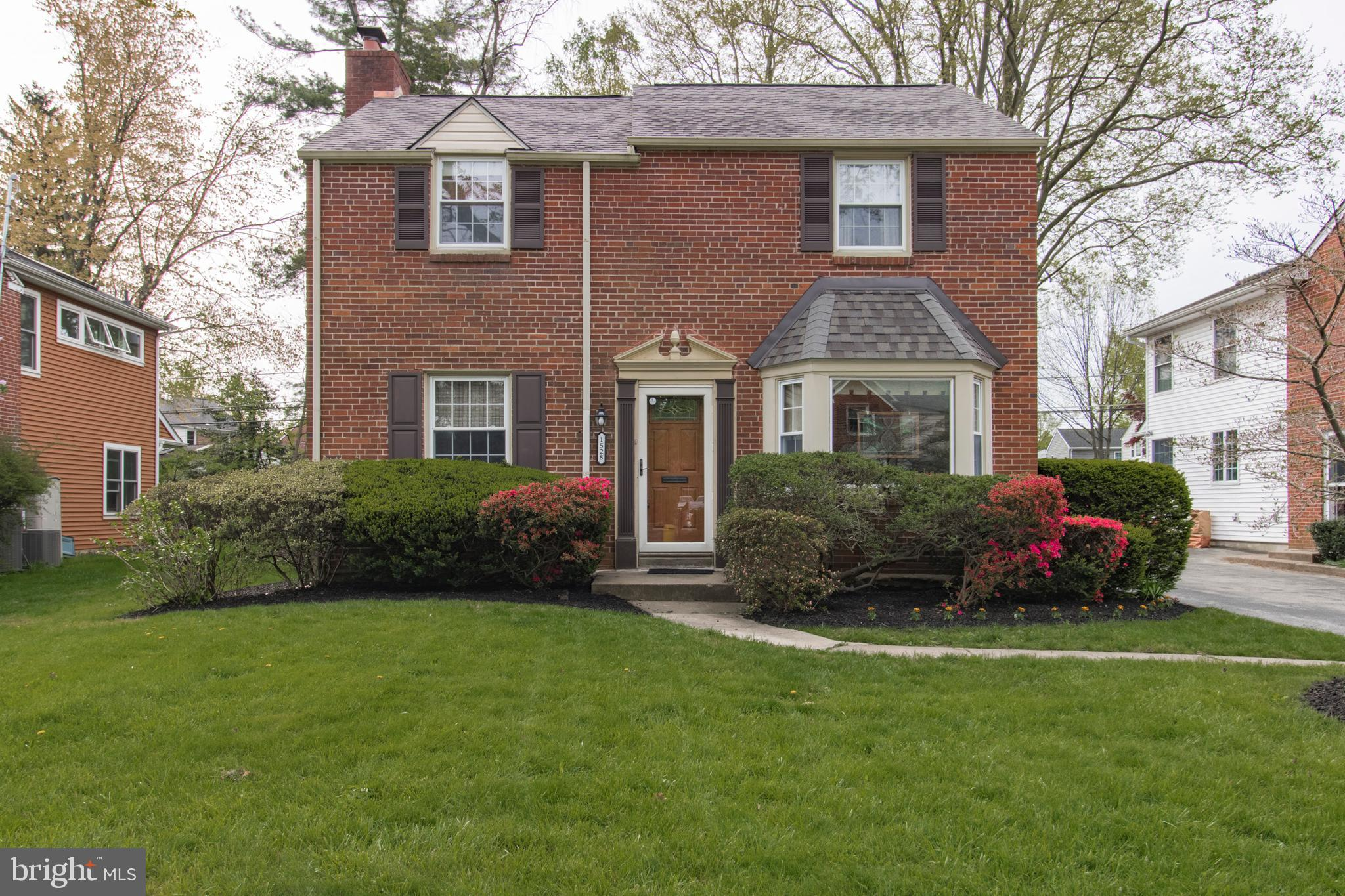 Welcome to 1528 James Road, a beautiful brick front colonial located in the award winning Lower Merion School District. This 4 bedroom, 2 1/2  bath home is just around the corner from South Ardmore Park, a fantastic spot to play tennis, baseball, talk a walk or grab the kids and head to the playground. The first floor presents a traditional layout, where you will be greeted with a sun filled living room featuring a wood burning fireplace with mantel and original hardwood flooring. An addition was completed, which now holds an entertainment room with plentiful custom built-in shelving, storage and a powder room. The kitchen includes stainless steel appliances, granite countertops, subway style backsplash and an additional entrance way for convenient driveway access. Entertain your guests in the adjacent dining room, which has a wonderful bay window overlooking the landscaped front yard. The main bedroom upstairs includes two custom closets, each with generous space and a full bath. This floor also has three additional bedrooms, each abundant in size that share a full bath. The home's backyard is spacious and gives plenty of space to entertain, play or just relax. What a truly wonderful location, enjoy everything it has to offer including being minutes to Suburban Square, Whole Foods, Train Stations and many restaurants!