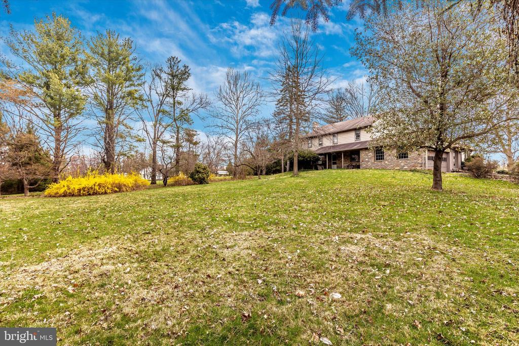 """Welcome to 2455 Mill Road in beautiful Jamison, Warwick Township, Bucks County PA. This home sits on a 6.46 acre open property with plenty of privacy. This 2 – story colonial has 4 bedrooms and 2.5 bathrooms. The home was built in 1965 and features a spacious sunroom and outdoor deck off the Kitchen. Enter through the front door with the Living Room and Dining Room on either side of the entranceway. The upstairs features 4 large bedrooms and 2 full bathrooms with attic access that has plenty of space for storage. The home has a 2 car attached garage with access from the first floor. The property has on-site well water, on-site sewage system, and the home is heated with oil and electric backup and electric Air conditioning. This property is perfect for a single user or an investor with potential of subdivision. This property is Zoned """"RA"""" – Residential Agricultural District, which has many potential uses which may include, but may not be limited to, Senior Living and Townhome Development. The property has a premier location surrounded to the south by a small Shopping Center with major Retailers. Across Mill Road, from the Site, are newer Townhome Developments with direct access to the highly traveled Old York Road (Hwy Rt 263). To the north and west of the subject Site are existing Residential Single Family Homes. Make an appointment to see this unique property / opportunity!"""