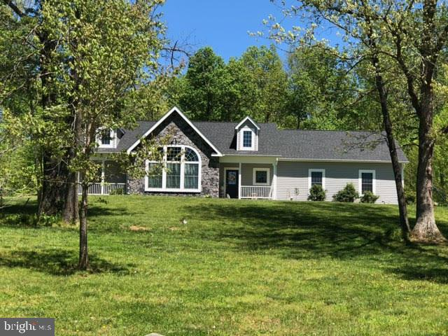 Current tax map shows 31 acres, in process of division which will be 11+ acres for this home. Secluded, quiet and nestled in the woods, this custom open floor plan home built in 2015. Sitting on over 11+ acres, featuring stone and siding exterior and multiple front porches it is quite impressive. It has 3 bedrooms and 3 full baths on the main level. Bedroom 3 is an in-law suite with kitchenette and a separate private entrance. The spacious master bedroom suite has a custom shower and walk in closet. Second bedroom has private porch and entrance. Laundry room off kitchen enters into the finished oversized 2 car garage. Hardwood and ceramic tile throughout. Ceiling fans, recessed lighting and cathedral interior doors add to the appeal of this home. Three foot doors throughout house for wheelchair accessibility. The great room features a vaulted ceiling with a massive stone arched see through fireplace. With 9 foot windows on one end and French doors with transom on the other, it is filled with lots of natural light. Paver patio off great room. Amazing kitchen boasts granite countertops, oversized cabinets, an island, large dining area which makes it perfect for family gatherings. The unfinished basement has 2,553 square feet and is plumbed for future bathroom and kitchen area. Basement has French doors that walk out backyard patio. Drain field is 4 bedroom perk so additional bedroom could be added in basement . No HOA Conveniently located between Warrenton and Culpeper