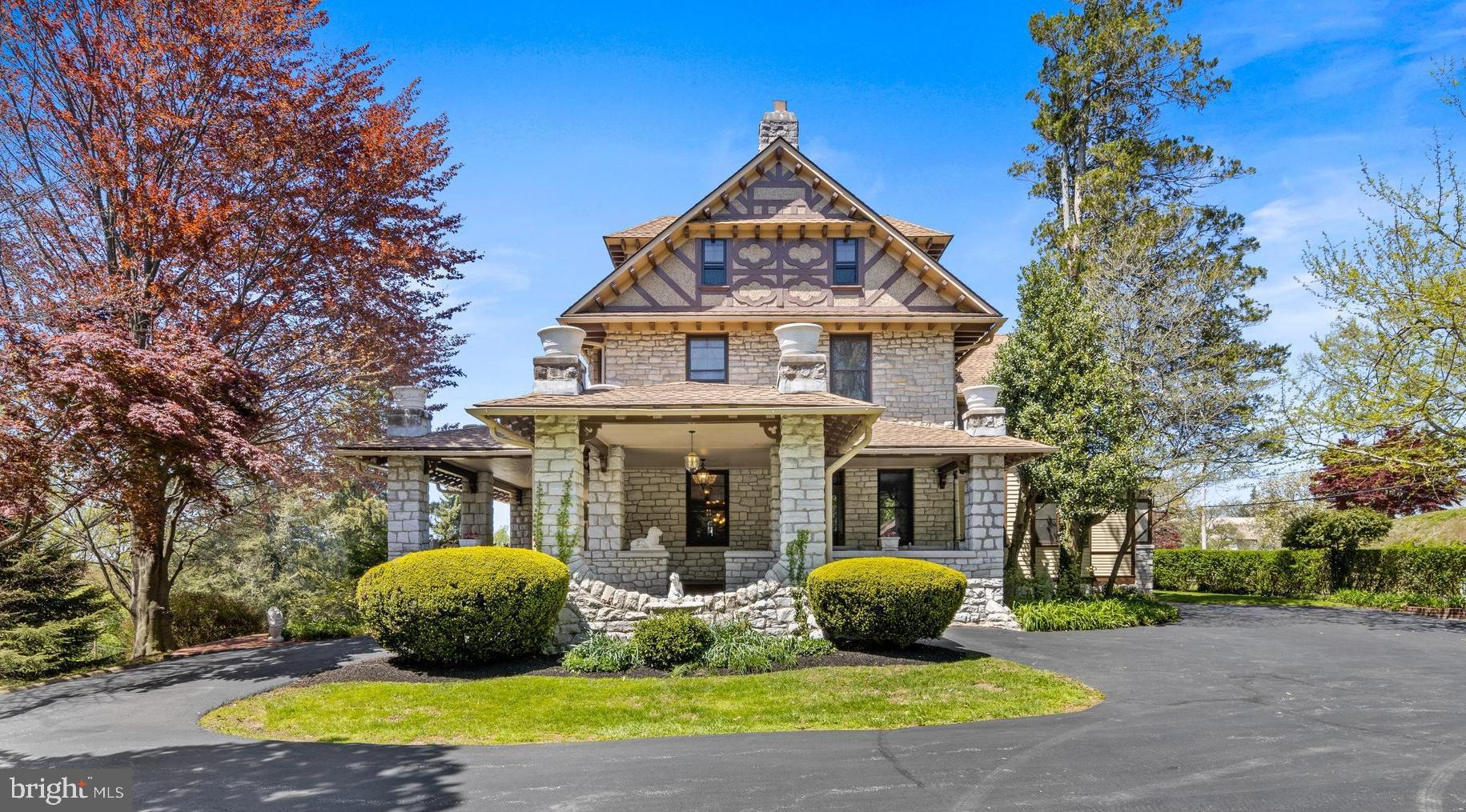 Welcome to Eyre View at 611 N. High Street; located on a full acre of land in the highly sought-after Northeast quadrant of the West Chester Borough. This stunning Victorian/English Tudor was the original home of Senator T. Lawrence Eyre and built circa 1898 by Joseph Miller Huston who was made famous by the construction of the Pennsylvania State Capital building in Harrisburg. Purchased in 1972 by the current owners, this home has been meticulously restored to its original historic beauty with spectacular architectural detail. As you pull up the driveway from N. High Street, you are led to the Porte Cochere and greeted by a beautiful wrap around porch with panoramic views of gorgeous sunsets and overlooking the West Chester Country Club. The front door entrance boasts a Grand Foyer with center staircase, chestnut wainscoting and hand carved gargoyles. The foyer is flanked by a Rococo style music room with original crystal chandelier and restored gold leaf detail and a Parlor/Living Room featuring a large fireplace surrounded by carved Corinthian columns and coffered ceiling. The formal dining room features a gas fireplace with custom built-in storage for all your entertaining needs, embossed ceiling and a statement Victorian chandelier. The heart of the home is found in the light and bright custom gourmet kitchen. Warm up by the Italian carved, white marble fireplace (ready for a gas insert) and cook to your hearts desire in this custom kitchen featuring two ovens, commercial cook top, subzero frig, two dishwashers  and direct access to the hardscape patio and pool.  The second floor features a large master bedroom en-suite with a grand dressing room, two additional bedrooms and laundry room with tons of extra storage, including a cedar closet. On the third floor you will find two bedrooms, full bath and original over-sized billiard room with wood burning fireplace.  Prime Location, Award-Winning School District, Low Taxes and walking distance to local parks, shops