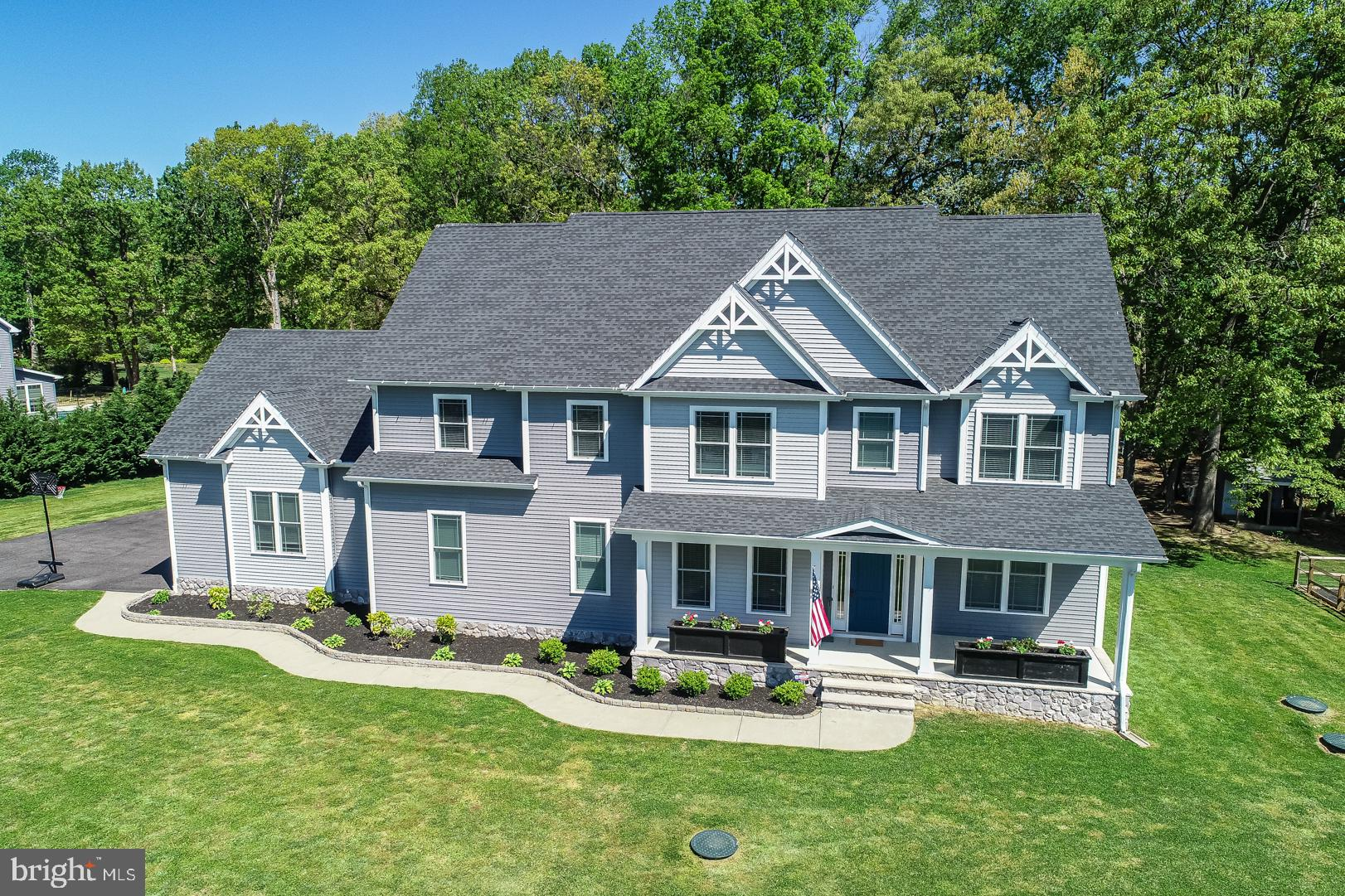 Welcome to your dream home! This beautiful custom home was built by C&M Homes in 2016. Located in the golf course community of Jonathans Landing it is just minutes from Rt. 13. The beautiful partially wooded lots backs up to wetlands, ensuring no future development.  Every detail has been thoughtfully addressed. The kitchen is ready to bring out your inner chef. Granite countertops, tile back splash, hardwood floors, and a large island will make cooking a joy. Pssst. There's a pull-out mixer shelf tucked away in the island! You have plenty of storage in the cabinets AND a large walk-in pantry.  The stone fireplace in the 2-story great room is topped off with an authentic barnwood mantle.  The craft room on the first floor is a great place for the hobbyist or a play area for the kids. There's ample storage in the large closet and vinyl flooring for easy care.  In the mood for a movie? The noise isolated home theater room has a 150 inch screen and connections for projector and 11.2 Dolby Atmos surround sound. This room has double drywall, acoustic ceiling and solid wood exterior door to isolate sound. Also has dual separate 20 amp  electric circuits to run the equipment. Floor step down for stadium seating with integrated step lights.  All bathrooms have tile floors. The main bath has a large soaking tub and separate shower with glass doors. The main bedroom closet will knock your socks off. It is huge! There are also 2 storage cubbies that are completely finished to store miscellaneous items like your Christmas decorations.  The large loft at the top of the stairs has space for a home office, reading nook, or study area for the student.  Everyone wants to stay connected today. This home is hard-wired for Category 6 Ethernet in all bedrooms, living room, loft and home theater. No need to worry about weak signal!  For your security the 4-camera on-site closed circuit security system with recording capability has you covered. Full home is offsite-monitored, online secur