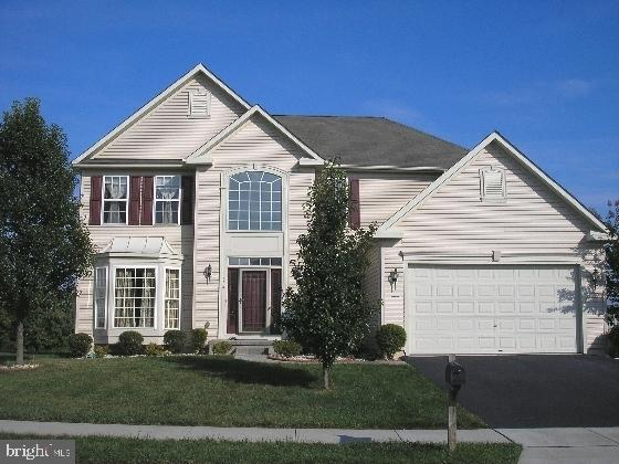 """Lovely 4br, 2.5ba executive home in Odessa National with near to 4000 sq ft of living area on premium lot.  Two story foyer with hardwood flooring.  Formal living and dining rooms.  Beautiful open kitchen with island, 42"""" cabinets, stainless steel appliances, built-in microwave, double oven and gas range.  Breakfast room with plenty of windows for sunlight and a great view.  Large family with gas fireplace.  Main bedroom with walk-in closet, bath w. double sink vanity, soaking tub and glass enclosed shower stall.  Professionally finished lower level with 3 separate rooms (den has 7 built-in speakers).   Two car garage with opener. Security system.  Two zone heating and air conditioning systems.  Large deck facing open space and golf course for marvelous view.  Seller will provide a one year AHS warranty on systems and appliances  for peace of mind."""