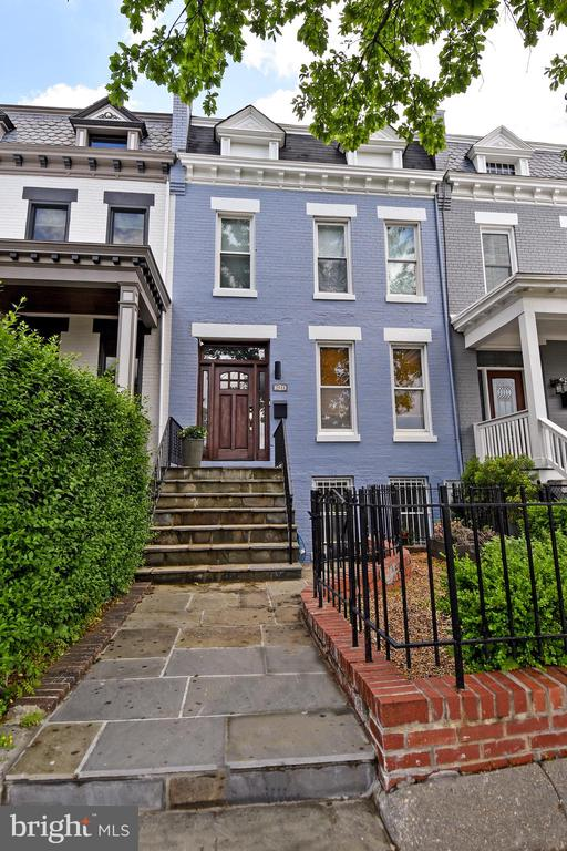 NOTICE: huge price adjustment just in time for the weekend. Though technically located on the edge of Brookland, this large home is actually just across the street from sought-after Bloomingdale. A slate walkway leads the way past the lovely front garden to a stunning entrance door. Inside, you will find that the owners have lovingly renovated the home for their personal use. There are upgrades galore: hardwood floors, exquisite light fixtures, a large living room with gas fireplace, and an open kitchen/dining area. Other features include a waterfall counter in Statuary Marble, herringbone floors done in slate, and modern cabinets with pull-outs and custom inserts. There is also plenty of storage, gas cooking, and a 4-door refrigerator with extra pull-out drawer. This floor includes a front-load, stacked washer and dryer, an elegant powder room with a black walnut counter, imported wallpaper, and access to the rear patio, secured 2-car parking and an electric car charger. There are 3 bedrooms of good size upstairs and two baths. White Subway tile adorns the hall bath and the owner's bath contains dual sinks, a glass shower door, and a towel warmer for stepping out of the shower on a chilly morning. Don't miss the custom walk-in closet. The lower level is self-contained for use by an in-law, an au-pair, or several guests. The owners have also been Airbnb Superhosts, resulting in an average of $2800 income each month. There is a small patio in front for chatting outdoors in good weather. The inside has two bedrooms, a living/dining area, a kitchen with butcher block counters, a washer and dryer, and a shower bath. Purchase and enjoy this gem for years to come.