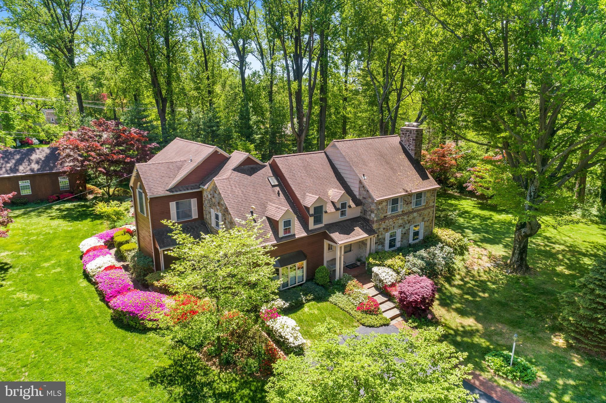 Wow! Wait until you see the beautiful, level yard at this new listing in Radnor Township! This gracious 4-5 BD, 3/2 BA stone colonial has great curb appeal and has been expanded with a 2-story addition, including a huge Master BD suite and a 1st floor Family Room. The floor plan offers circular flow throughout the 1st floor, from the Entrance Hall to the formal Living Room, to the Dining Room, Kitchen, and 2 Family Rooms. Flexible floor plan offers multiple areas for casual everyday living and gracious formal entertaining. The cozy step-down Family Room offers ample space for relaxing and watching TV. Sunlight streams through large windows in a Family Room addition, currently used as a Breakfast Room and Office.  Walls of windows also brighten the tiled, heated Sunroom, which overlooks the large side yard and opens to the Dining and Living rooms. The Kitchen features loads of counter space and a commercial-style gas range. Closets, 2 Powder Rooms and a Mudroom complete the main floor. Upstairs, soaring vaulted ceilings highlight the huge Master Bedroom, which also has a walk-in closet and a large Master BA with shower and separate tub. Bedroom 2, which was the original Master BD, has 2 closets and an en suite 2nd full BA. Bedrooms 3 and 4 share the 3rd Full Hall BA. The upstairs Office has a closet and accesses the convenient upstairs Laundry Room. This room could also be used as a 5th BD (Laundry was originally a BA.) The finished lower level Recreation Room has a fireplace plus multiple closets and several unfinished storage rooms add more storage space. The detached, oversized 2-car Garage has an additional extra storage bay for sports and yard equipment. A large upstairs loft over the garage offers great storage and potential for additional finished space or a private office or exercise area. Enjoy relaxing on the expansive rear deck and unwinding after exercise or a long day at work in the jetted hot tub. The sweeping grassy lawn offers great space for outdoor recreation, gardening, sports or even a pool. Flowering shrubs line Belgian block paths. Bordered by mature plantings for privacy, this property is located on a cul-de-sac street in a residential neighborhood in Villanova. Easy access to shops, restaurants, parks, schools, and universities. Convenient to the Blue Route, turnpike, Center City, Airport, and corporate centers. NOTE: Delaware County conducted a real estate tax reassessment in 2020 and tax records do not yet reflect accurate school taxes. If you have any questions or concerns about the impact of the reassessment process on the future real estate taxes for this property, please contact the Delaware County Treasurer's Office.
