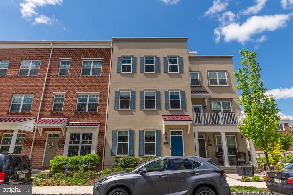 """NEW CONSTRUCTION WITHOUT THE WAIT! Nestled in the waterfront community of Waterside, this is one of the largest units in the community and one of the few with a 2-car garage. This home offers so many opportunities to share outdoor parties and activities with your family and friends. One of the few units with a rooftop river view. Half of the roof deck is laid out as a deck with the potential of expanding to the other side. Just a block away from the river's edge which leads to Central Park. While relaxing or picnicking you'll have access to a waterside view of the Delaware River where you can watch the boats sailing in and out of the Philadelphia Yacht Club. A short drive up State St is the Neshaminy State Park filled with walking and bike trails.  Or take your friends to the Broken Goblet Brewery for a cold one on a hot summer night. This home was built by custom home builder """"Mignatti"""" before the community was bought out. The Mignatti homes are known to have extra features and high-end finishes. This home has a large functioning living room on the main floor and the opportunity to have a large home office, playroom or theater room in the lower level. With 2,618 sq feet of space, this home offers a large, open concept great for entertaining or hanging with the family.  Enter the home through the hardwood laid foyer that leads up a set of stairs to the kitchen, family room and dining. The eat-in gourmet kitchen has granite counter tops, designer 42-inch cabinets, wood floors and stainless-steel appliances including a new dishwasher, new microwave, a gas range/oven, large island and pantry.  From the kitchen you have full unobstructed view of the family room and dining area. The second set of stairs accessing the second story from the family room brings you to the Primary Bedroom and Primary bathroom. The primary bedroom has dual walk-in closets. The primary bathroom has granite counter tops and dual sinks. Also on the upper level, the carpeted hall leads to 2 other """