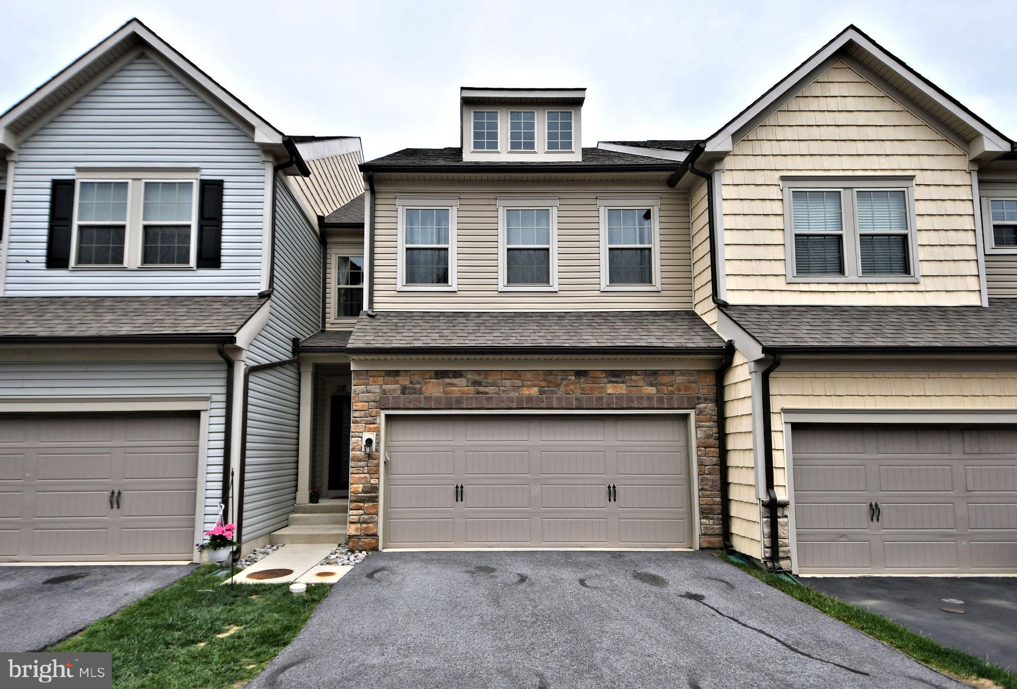 *** Showings Start 5/14 *** Highly upgraded, Stunning, Luxurious Adirondack Model 3 BR, 2.5 BA Finished Basement Carriage Home in the highly desired Linden Hall Community! Award winning Great Valley schools! This 4 year young townhome has finished walk out basement, 2 car garage, sunroom, abundant recessed lights and Golf Course view from the maintenance free deck.  As you enter into the foyer, you will be greeted dark colored hardwood floors with wide plank. Upgraded Kitchen with Timberlake cherry wood cabinets to invite the chef in you with huge center island, granite countertops, custom tile backsplash, undermount sink and pantry. BRAND NEW Dishwasher and Stainless Steel Fridge, Gas Range and Rangehood. Nice sized light filled Family Room for your gathering and an additional sunroom to enjoy. Nice sized Trex Deck with golf course views, powder room and oversized 2 car garage round out the first floor. As you go up the elegant hardwood stairs with metal spindles, you are greeted with the huge master bedroom on your left and the other bedrooms on your right. Huge Master Bedroom with a sitting area, huge walk in closet, recessed lights and ceiling fan.  Retreat into the luxurious Master Bath with  upgraded tiles, granite vanity top, double sink and oversized tiled shower. Large windows allow for more natural light throughout the second floor. Two other nice sized bedrooms with ceiling fans. A study nook in one of the bedrooms is perfect for your work from home needs. Upgraded hall bath with granite tops and tiled tub shower with tiled floors.  Convenient second floor laundry. Fully finished walkout basement for multiple purposes - office space/play area/gatherings/additional bedroom. There is a drywalled rough in plumbed space for a future bathroom.  Additional driveway parking in addition to the convenient oversized two car garage and additional street parking near by.  HOA handles lawn and snow. Minutes to Rt 30, Rt 202,  PA Turnpike and Septa. Convenient to Exton