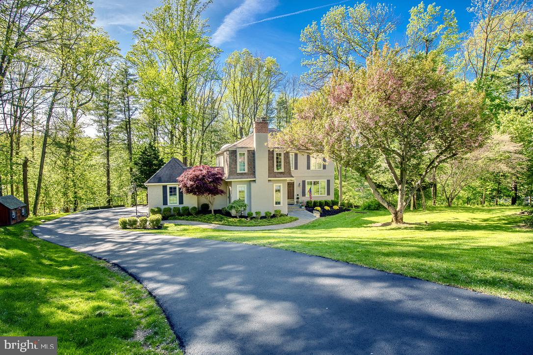 This delightful French Country two story home sits at the end of a quiet cut de sac in Radnor Township, surrounded by lush landscaping and mature trees that frame the house and enclose the backyard.  A large portion of the backyard was leveled to enhance the area for recreation and play equipment.  Enjoy the beauty of the yard from the expansive new deck that stretches the entire length of the home, with ample room for dining, entertaining and relaxing.  Entering into the Foyer, the contemporary style open floor plan is immediately evident as large archways lead into the living spaces.  The formal Living Room  has lovely custom molding and hardwood floors that continue into the Dining Room that features glass doors out to the deck.  This opens into the updated kitchen with new tile floor, large island, gas range with grill and hood, ample cabinetry with many glass fronted display cabinets, granite counters, recessed lighting, and a large breakfast area with glass doors to the deck.  The Kitchen/Breakfast Room is open to the very spacious Family Room that has two distinct spaces - a step down more intimate area for gathering around the fireplace and an open area with wet bar for easy entertaining.  The Laundry Room is accessed from the yard and has excellent storage space and folding table, and the Mud Room with entrance from the garage also features new tile flooring.  The updated Powder Room with new marble tile floor  and granite topped vanity completes this level.  The second floor offers an elegant Master Bedroom with tray ceiling, walk in closet with window, hardwood floors, and large two room Master Bath with double sinks, newer stall shower and soaking tub.  The additional Bedrooms all have excellent closet space and are served by the hall bath with  large vanity, tub and shower.  The basement is very spacious with high ceilings,  and currently accommodates a large playroom with  trampoline and play area, and also has room for a blow up bounce house, and even