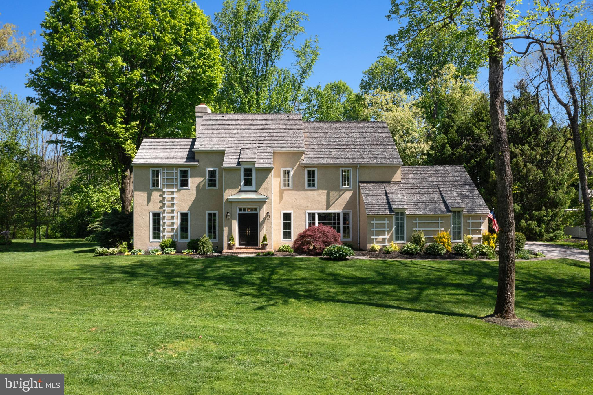 Welcome home to 406 Round Hill Rd, a lovingly maintained colonial in Radnor Township School District.  With over half an acre of flat and private manicured yard, this quiet and tucked away street in the Roundhill Development will have you falling in love. Through the two-story sunlit foyer entrance you will find a very spacious Dining Room with wood burning fireplace on your left, and a large sitting/Living Room on your right.  Walk into the open and updated Gourmet Kitchen complete with granite countertops, soapstone farmhouse sink, glass door cabinets & stainless steel appliances. The 2-story family room provides even more sunlight with its dual skylights and vaulted ceiling, also complete with a wood burning corner fireplace. A stylishly updated powder room completes the first floor. Up to the second floor (which has been recently fully re-carpeted) you will find a good sized Master Bedroom with walk-in closet, updated ensuite Full Bath and 3 other bedrooms each with its own closet space.  You will also find another beautifully updated hall Full Bath on this floor. Other updates include a gorgeous fully finished basement which could be used as a home office, extra hang out space or tons of storage. Brand new windows throughout house,  a yard that is bordering The Willows and a short walk to the nature preserve pond,  you don't want to miss this beauty in coveted Radnor Township!