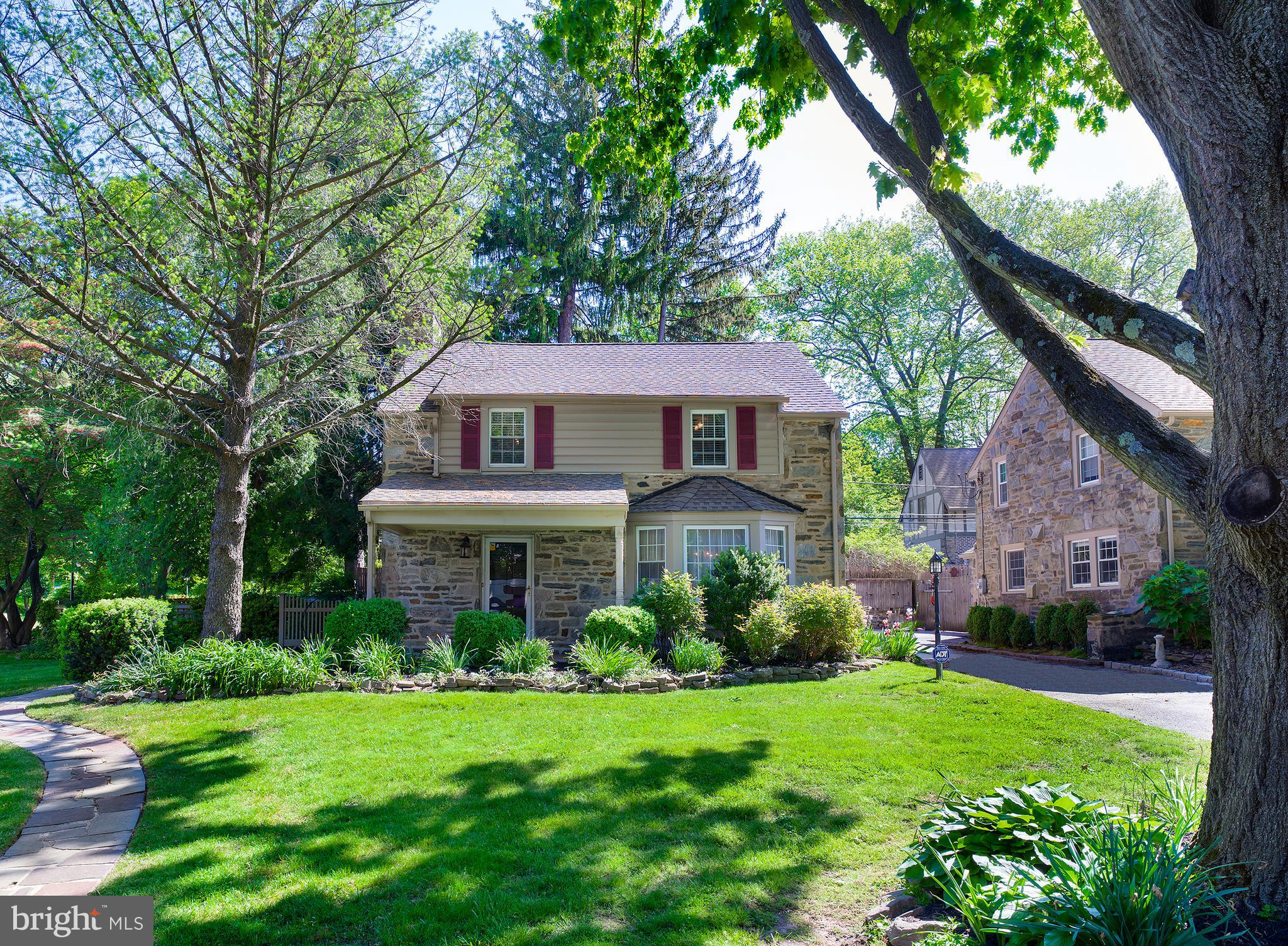 Enjoy the best of all worlds – great schools, low taxes, and incredible proximity to the culture of Center City – at 21 Allendale Road, a charming 3 bedroom, 2.1 bath stone colonial ideally located in prime Wynnewood. Set on lovely landscaped grounds on a large coveted corner lot, the home invites comfortable living, in a fabulous family-friend neighborhood offering picturesque beauty and a true feeling of close community.  Current owners have loved and well cared for this special gem for many years taking full advantage of the generous living space and exceptional address. Sit outside on the lovely covered porch and read or relax with a coffee while savoring the serenity. Or spend time outdoors on the rear patio dining alfresco and entertaining.   Inside is gracious and welcoming with hardwood floors and tasteful details, featuring a generous living room centered by a wood-burning fireplace to gather around with loved ones and guests. Share meals and celebrate holidays around the table in the formal dining room that is conveniently connected to the sunny kitchen, appointed with wood cabinets and granite countertops. Lounge, play games, watch TV and have a snack in the nearby family room, and when the weather is nice, step out the glass door to the timeless brick paver patio with plantings and privacy fencing.  Three sizable bedrooms reside on the upper level and provide a quiet place to land at the end of a busy day. The primary bedroom has an en-suite bathroom, plus there is a full hall bath for secondary bedrooms. A semi-finished basement with a den, dry bar, powder room and lots of storage, shared driveway, and security alarm system are among the other highlights. Come fall in love with this special home and even more so, in the amazing location you have been looking for!