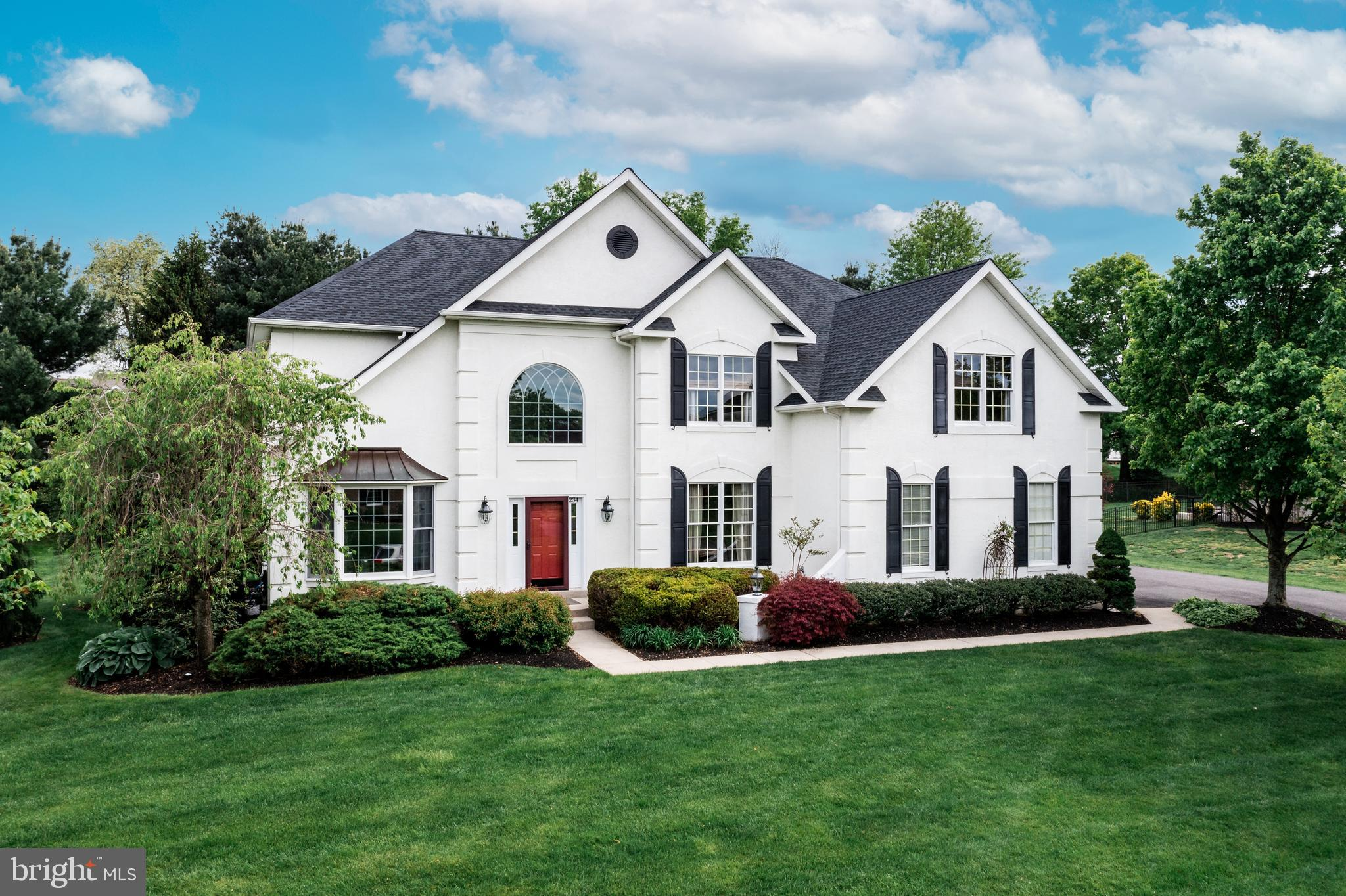 It's not that often you can find such a prestigious home in the much desired Laurel Creek neighborhood while still having absolute privacy too. Here is your chance to have the best of both worlds- country club life with a quiet lot tucked away to enjoy. Enter into this Harvard model to find a 2 story foyer with tons of natural light and hardwood flooring. The attention to detail can not be overlooked throughout this downstairs. With neutral decor and high end finishes, this home is truly move-in condition. Crown molding, shadow boxing, professional paint and more are just a few of the highlights of the first floor. Enjoy an open floor plan with a large sunken family room complete with custom stone mantel, a wood burning fireplace, and textured carpet. The exterior wall is two stories of floor to ceiling windows, and is absolutely breathtaking. The kitchen is equipped with a full stainless steel appliance package, 42 inch white cabinets, large pantry, island, and granite countertops. To complete the first floor you will find a powder room, tinted windows, and a spacious home office with built-in shelving and windowed doors to give you privacy for working without feeling like you are locked away in an office all day. Head upstairs to find dual staircases that are tastefully decorated with a wood and wrought iron banister, professional stairway runner, and high end neutral carpet. There you will find a master with the primary bath that has recently been updated with all the modern conveniences. The bedroom is spacious with plenty of storage, recess lighting and tray ceilings. There are 5 total bedrooms and 3 full bathrooms, including the primary bath. All the bathrooms are fresh and updated. But that is not all! Head down to the basement for additional living space. Here you find a full finished walkout basement with brand new plank floors and powder room. The options are endless with this space! And here is the best part! If you are passionate about improving your swi