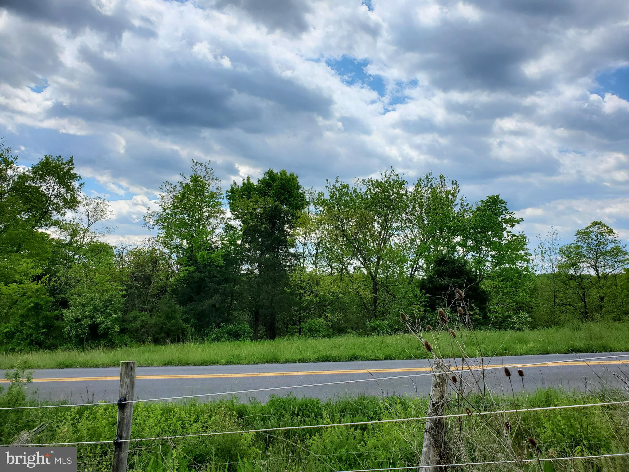 Bring you horses and build your dream home.  Unique property, unrestricted with creek access.    Note taxes have not been recorded with the new approved plat of the 9acres. Appointment only with your Realtor present! Please do not ask neighbors