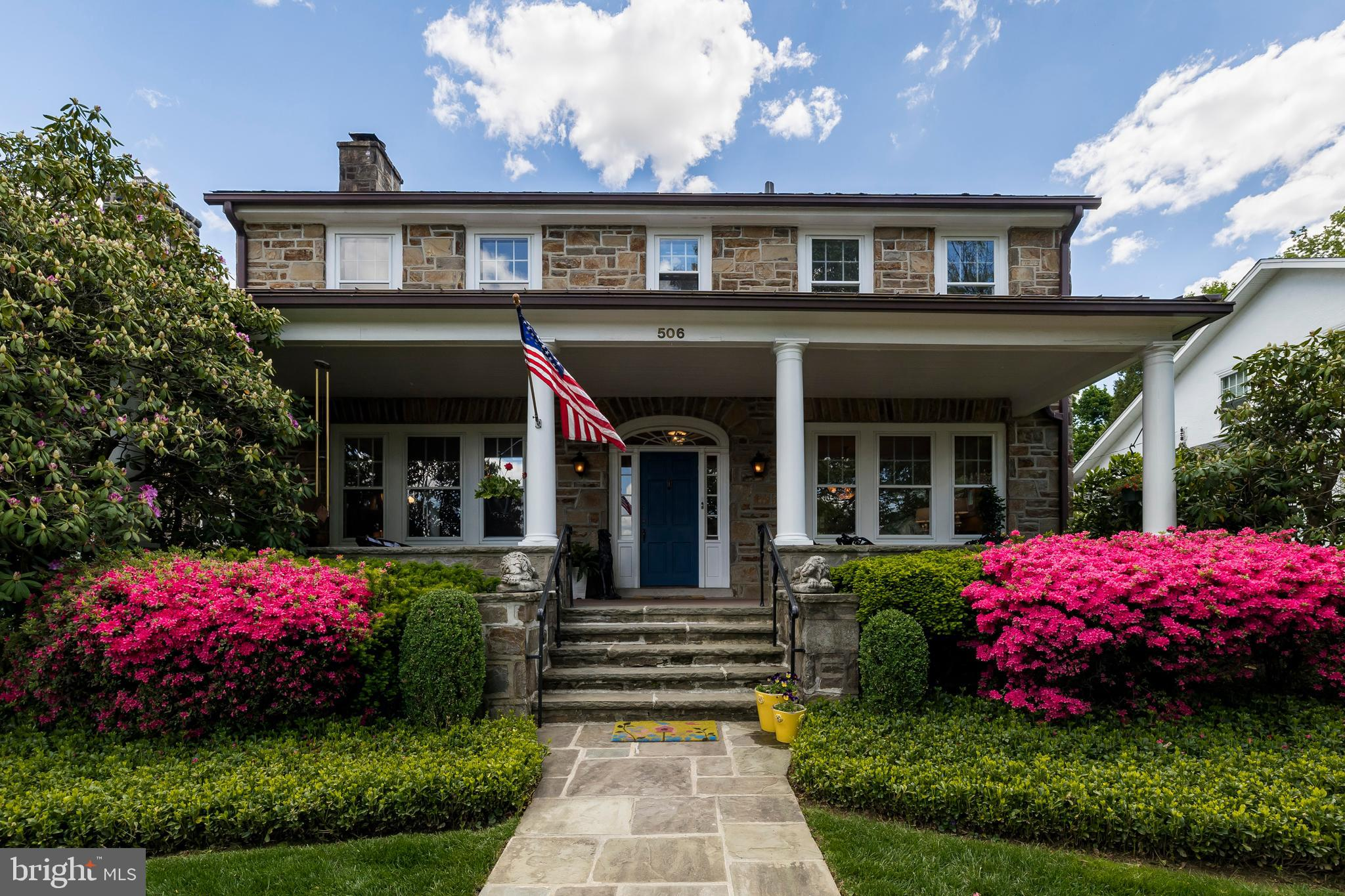 """CLASSIC Stone Single c1935 on Beautiful Price Street in West Chester Boro!  3060Sqft  3Bedrooms  2.1Baths  Walk-up Attic  1+CAR Garage & Extra Parking   AND  the MOST Enchanting Garden Landscape…  Manicured & Loved for 35+years by the current owners!  3Seasons of Blooms & a Koi Pond, too!  Summer Glorious Gardens just starting!  Plus, the Gracious Covered Front Porch!  Timeless Architecturals: In-Laid Hardwoods throughout, Stone Fireplace, 9ft Ceilings, Deep Window Sills, Extensive Original Millwork, Tin Roofs,  """"LARGE Rooms"""" is an understatement, come discover more…  Main Level: Grand Foyer, Great Room  16X24  Stone Fireplace, Office/Den, Powder Room, Dining Room,  '60's Kitchen,  Entry to the Awesome LUSH Backyard & Terrace, Beautiful Custom Fencing.  Laundry Room.  Upper Level: Primary Bedroom: 14X25   RETRO Lavendar & Black Tile EnSuite Bath, 2 generous sized Bedrooms, Hall Bath, Walk-in Cedar Closet.  3rd flr Walk-up Attic:  LARGE Unfinished Space, 4thBedroom or add your personal touch!   Lower Level:  1490Sqft Storage.  yes, some Vintage Features, BUT,  Still does not dim this Spacious Beauty's Style & GOOD Bones!  A short stroll to Parks, Uptown & Restaurants.  This front porch is just waiting for your wicker furniture & a mint julep!   ...  ***See the Virtual tour for Flr Plans, 3D, Video ++"""