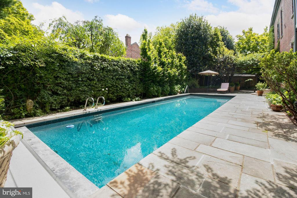 Ideally situated in private enclave in Georgetown's sought-after East Village, this 6BD/5.5BA townhouse sits on nearly 6,000sq/ft lot, making for a private residence, not to mention its own Private Pool and Patio. Fully updated in 2020, this home features high-end finishes, hardwood floors, recessed lighting, and upgrades throughout including full Waterworks Bathrooms. Main Level features an open floor plan that boasts light-filled, spacious living spaces which seamlessly integrate into the sprawling patio through several sets of French glass doors. Level also includes updated gourmet Kitchen with Viking appliances and marble countertops. Other features include gracious Owner Suite flooded with natural light, includes Sun Room with skylight and large surrounding windows,2 closets, and en-suite Full Bath with Waterworks fixtures, soaking tub, dual vanity with marble countertop, and steam shower with marble tile. Situated in private enclave and sited on nearly 6,000sq/ft. Complete with stunning Side and Rear Patios made private by surrounding foliage. Private Pool and 2-car Garage.