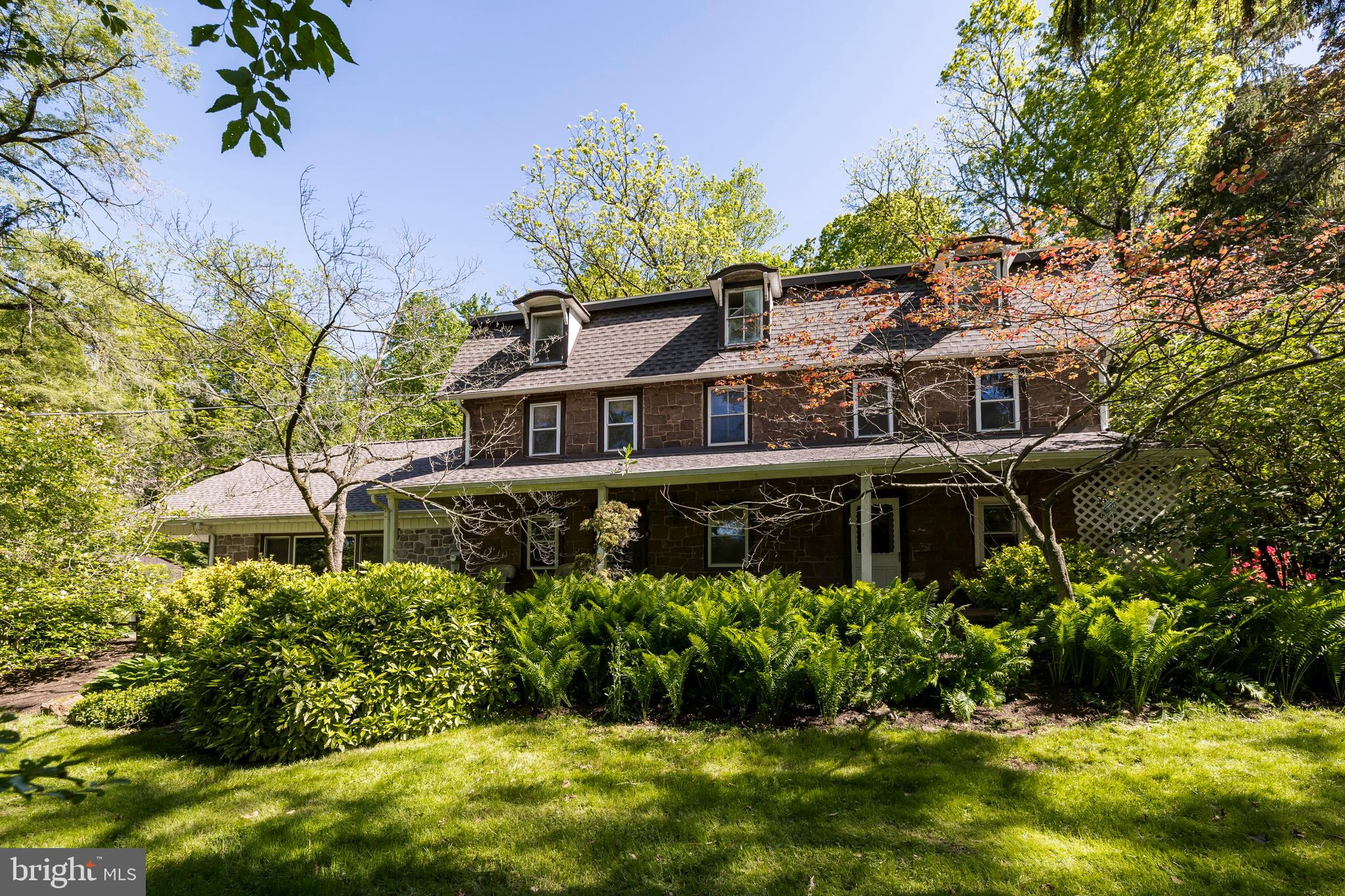Own a piece of Chester County history! Built in 1758, this gorgeous farmhouse was once part of the local sheep herder's farm. This charming stone home has been expanded over the years, resulting in a very comfortable space that retains much of its original charm including exposed stone walls, beams, and hardwood floors. The main level includes a huge 25x25 family room and Kutz-built addition from the late 1960's, which is an amazing space for entertaining and was once the recital room for a local piano teacher! There is also a convenient powder room and coat closet. A large hallway of built-in cabinetry connects the addition to the original portion of the home, which could be used as a large formal dining room or multipurpose room. You can't help but fall in love with the deep windowsills and the exposed beams! Imagine all of the owners that have lived here... before the roads were cut in, before plumbing... even the current fireplace with wood stove insert used to be a walk-in fireplace. Just off the dining room is the kitchen, which is part of an addition from 1768. The kitchen has ceramic tile floors, butcher block island, and access to the huge private front porch! There is also a stairwell that leads to the 2nd floor where you will find two rooms that share a full bath. The 3rd floor has three additional rooms with original flooring. Outside you can enjoy almost 1.6 acres of wooded privacy, with plenty of room for outdoor activities and gardening. There is a large shed and plenty of parking for party-time! The home has a new roof (2019), newer heater and water heater (2018), replacement windows, replacement oil tank (2014), updated 200AMP electric, and public sewer. All you need is your creative vision to transform this house into your dream home! Come and write yourself into the next chapter of Chester County history!