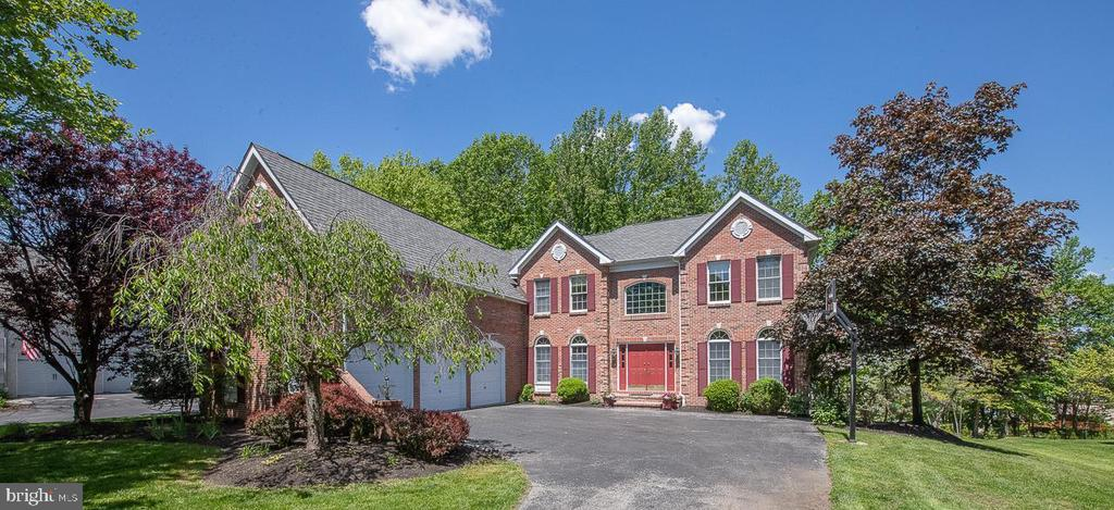 """Welcome Home! This large, brick front colonial has been updated in the most appealing way.  If you have been waiting for a home in true move in condition, this is it! Located on a quiet cul-de-sac in popular Valley Forge Woods. The gracious 2 story Foyer welcomes you with Hardwood floors, a dramatic staircase, and a terrific flow to all rooms.  Beautiful traditional center hall offers the  formal Living Room to the right and formal  Dining Room to the left.  Both have wonderful moldings, arched windows, new hardwood floors, and have been freshly painted.    Straight ahead is an enormous Family Room with soaring ceilings, and windows.  New wood floors and a 2 story gas Fireplace, two sets of French doors open up to the expansive deck overlooking your private back yard.  For working from home, there is a private office.  The kitchen has 42"""" cherry cabinets, tile floor, new white granite countertops, a large walk-in pantry, a kitchen desk, and island work space. Updated Stainless steel appliances include a gas cooktop, double oven and dishwasher.  A spacious breakfast area connects the kitchen and the family room - the perfect floor plan for entertaining!   A spacious laundry room, Powder room, and Mudroom connecting  to the 3-car garage completes this level.  Convenient Backstairs ascend to the second level.  Looking for Luxury? The primary suite will delight you! Consisting of a sitting room/office with custom built-in bookshelves, an oversized bedroom and a hallway of closets - 4 walk-ins to be exact.  The large en-suite bath has a deep soaking tub, a separate shower, double vanities, as well as a makeup vanity.  Bedroom #2 also has an en-suite bathroom. Bedrooms #3 and #4 connect with a Jack & Jill bathroom. The walkout lower level offers even more finished space including a 5th bedroom and full bath, media room, and large open TV/game room area with wet bar, and another office/hobby room.  Unfinished storage space as well.  Recent updates include 2 new HVAC units,"""