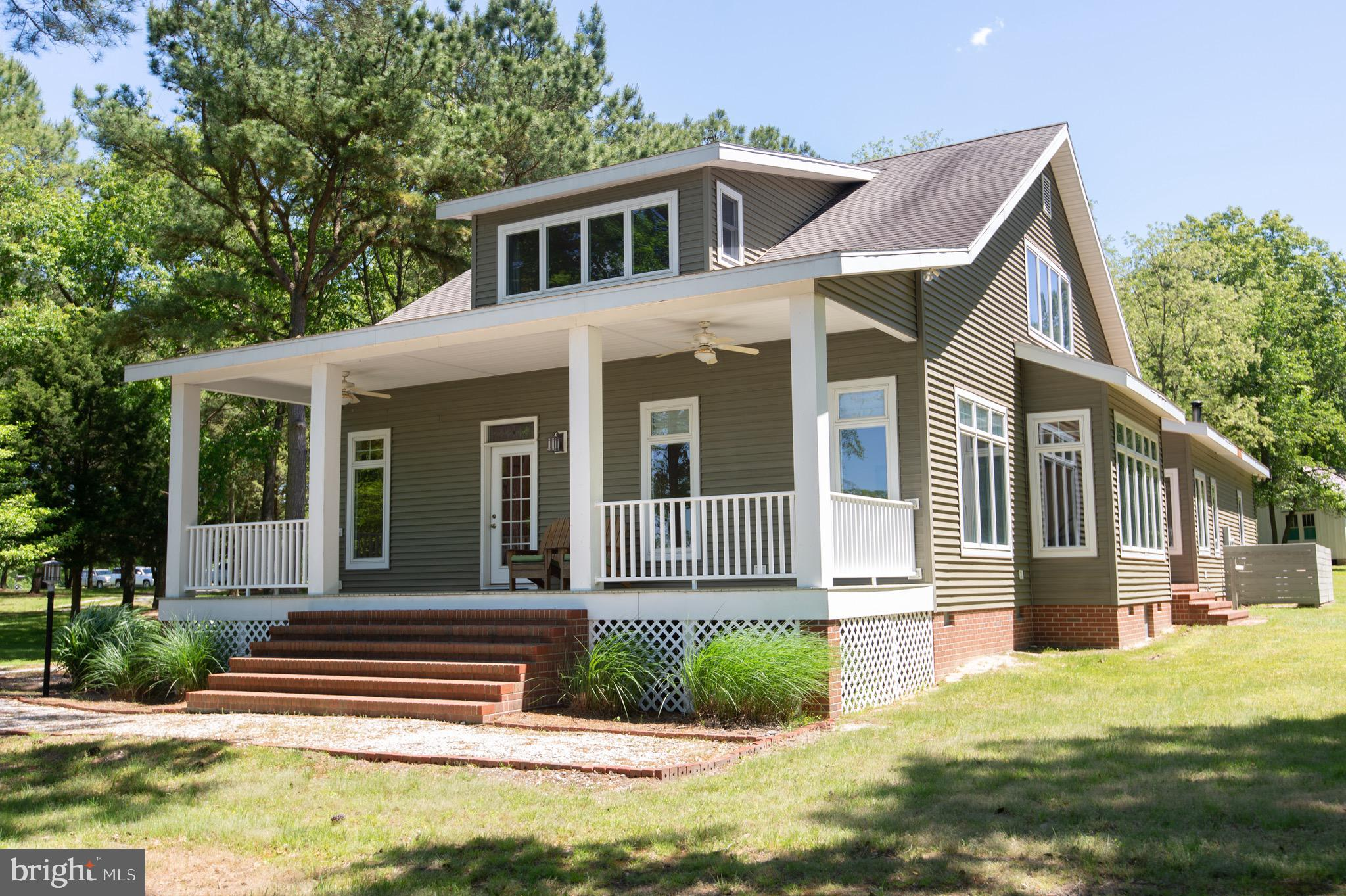 Exceptional home - exceptional location!  Enjoy the bright interior of this Craftsman style  home on 5 +/- wooded acres, built by a local master craftsman.  It features  9 ' ceilings, and a  well thought out floor plan offering true Eastern Shore views of water, marshes and woods. Porches on three sides. Located on a cove off of Cabin Creek, you will love the  peaceful view of the water and it's  a  great spot for kayaking, bird and nature watching .  Hardwood floors throughout.  Large master bedroom suite on the first floor, with double vanity and walk in closet.  The kitchen/family room has a large island and a fireplace. Additional dining room and living room. Two bedrooms, a full bath, and a loft area offer versatility on the second floor.  Separate utility room , and an additional half bath, loads of closets and  storage space throughout.  2 car attached  garage,  neat upcycled outbuilding,  and woodshed.   Very cool observation/sleeping platform in the woods.  Warwick School District. Nearby Suicide Bridge and Snug Harbor marinas offer deep water dockage.  One owner loved - you don't want to miss it!
