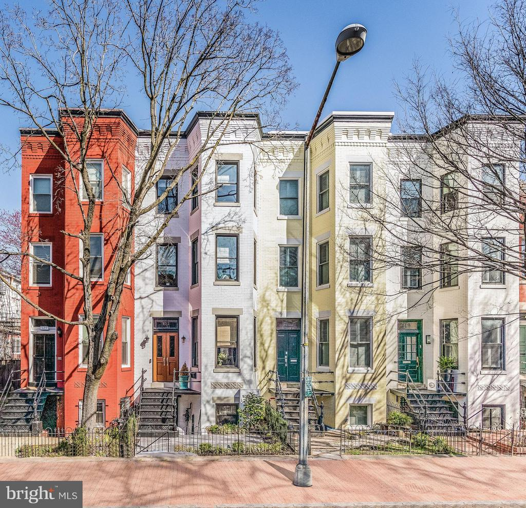 """Ideally located just one block from Stanton Park and within close proximity to the US Capitol, this two-unit row home is one of four homes that was designed and built by S.H. Walker, a prominent Maryland architect well-known for constructing upscale, finely crafted homes. The spectacular location, coupled with the original character of the home inspired a complete top to bottom renovation in 2019. The front yard features a restored iron fence and steps leading to the main entrance with mahogany oversized double doors, and a private vestibule with custom-designed marble floors and an original glass transom. The interior highlights exquisite finishes from top to bottom, including an open concept floor plan on the main level in addition to 4 bedrooms and 4½ bathrooms. The rear exterior doors are the finest, double lock French doors leading from the spectacular gourmet kitchen with high-end stainless steel appliances, onto the exterior rear deck. The English garden apartment entrance is under the wrought iron staircase, which leads to a light-filled two-bedroom apartment with a Certificate of Occupancy in place, allowing the new owner to live on the main level and rent out the lower level. Rounding out this spectacular home, the rear exterior offers a solid wood privacy fence, a custom stamped concrete patio designed to accommodate multi-car parking with a secured remote garage door, and a charming deck, perfect for entertaining. Just blocks from the Eastern market, restaurants, shops, and nightlife, this home is a """"walker's paradise"""" with a high walk score of 94."""