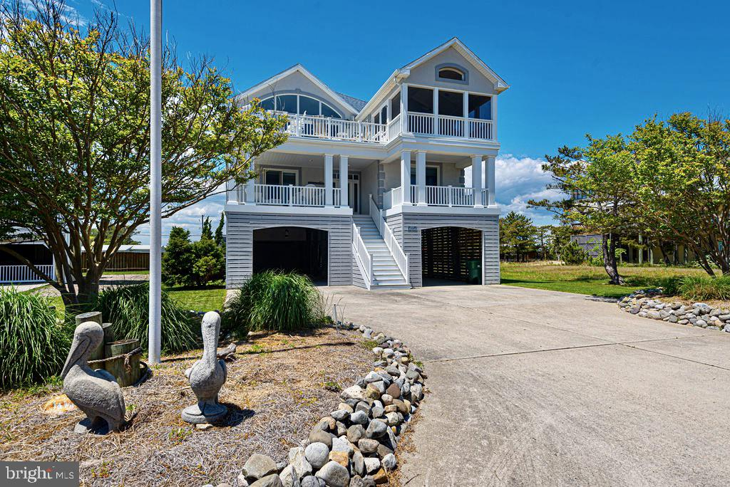 Just what you have been dreaming about.   Panoramic views of the Ocean, Bay and Fenwick Preserve area.   Imagine viewing an amazing sunrise over the Atlantic Ocean and Brilliant sunsets over the Bay all from one dynamic home.   This pristine custom Zonko built home is host to the best of the best builder features.   Double outside shower for all of those beach days.  A grassy landscaped fenced backyard area.  This home is ideal for the oversized family and entertaining.  Each 6 bedrooms as a ensuite with private bath.    Great room with soaring ceilings,   Dining area with imported Ceramic tile flooring, Chefs kitchen with 42 inch wood cabinets, granite counters, 6 burner gas stove, stainless appliances, large kitchen eat in counter all overlooking the screen porch and open sundeck with beautiful ocean views.  Built in bar area on the deck for ultimate entertainment.   Bayview deck with lovely sunsets from additional sitting area equipped with gas fireplace.  Owners ensuite with walk in closet, bay views, spectacular bathroom with oversized ceramic tile shower.  Guest bedrooms on the second floor all ample space accessed with open wide hallway and elevator with custom murals and artwork.  TV/Media room with Ocean Views and wetbar.  Multiple decks and taken well care of by the owner.   Deck/Screen porch flooring is imported low maintenance beautiful decking.  This home is one of a kind with space, luxury and amazing sought after Fenwick Island location.  This private enclave of homes is gated and positioned just a short bike to all the most popular restaurants.  A must see for so many reasons.