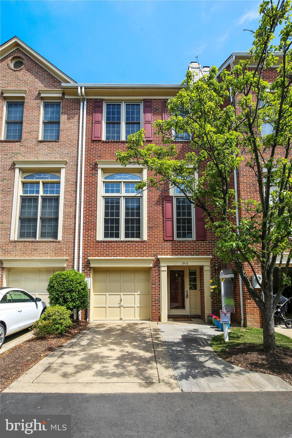 Rarely available Clarendon/Lyon Village townhouse in the Lyongate community that's been renovated from the top to the bottom! The tile foyer includes a coat closet, entrance to your 1-car garage, a den with closet, laundry, and utilities. Upstairs you'll find Brazilian Cherry hardwood floors throughout. The family room has 12-foot ceilings and is flooded with natural light from the tall windows. The family room has a wood-burning fireplace surrounded by built-in shelves. The renovated kitchen includes white cabinets, Quartz countertop, stainless steel appliances, subway tile backsplash, cork flooring, eat-in area with extra cabinets, chalkboard wall, and sliding glass door to a fenced-in slate patio. Upstairs you'll find a unique 2-story primary bedroom. The first level is the sleeping area with closet, which leads to a short staircase up to your renovated bathroom with large walk-in shower with glass door, dual vanity countertop, water closet, and large walk-in closet with Elfa shelving and access to the attic eave. The other 2 bedrooms share a hall bath with tub/shower. Located just 1 block to the Lyon Village shopping center (including Italian Store, Starbucks, and Giant), 1 block to the Lyon Village sprayground, and walkable to two metro stations: Courthouse (0.5 miles) and Clarendon (0.6 miles). Owners also enjoy easy commute access to Georgetown, I-66, and the GW Parkway.  A long list of updates includes: Fence – 2010, Elfa in Primary Closet – 2010, Roof – 2011, HVAC – 2012, Primary Bath – 2013, All Windows and Sliding Glass Door – 2015, Guest Bedroom Elfa Shelving – 2015, Kitchen – 2018, Slate Patio & Front Walkway – 2019. The HOA has 4 guest spots available for use or street parking on N Daniel. HOA includes outdoor landscaping, snow removal, and funds for long-term projects.