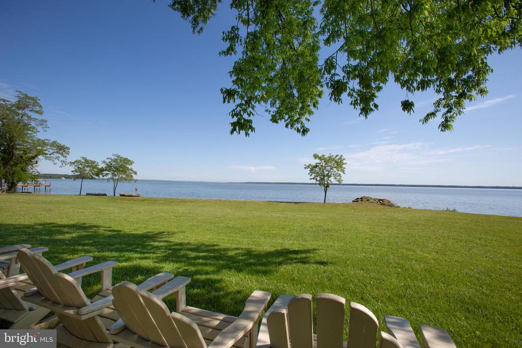 One of a kind gem on a breath-taking panoramic point of the Potomac River. With 5 acres of waterfront property (additional 5 acres of waterfront land adjacent to subject property is for sale as well, both parcels may be purchased together for $2,200,000). Located just 20 minutes from Downtown Fredericksburg on the scenic Belvedere Beach, this land has been perced for 4 bedrooms and ready to support your dream home and sprawling pier. Ripe with history, this land was the home of the Belvedere Hotel and Casino. People from all over, with the likes of Patsy Cline and George Jones, would travel by boat and car to the Hotel and enjoy everything from live bands, gambling, fine whiskey, and beautiful views. Once a central hub for travelers and thrill-seekers, this land has cultivated culture renowned in Virginia since the early 1900s. The current owners have amassed a collection of news articles about the land dating back to 1926.  With 203 feet of prime water frontage and beach, paradise is just a leisurely stroll through your back yard or viewing from the comfort of your newly built dream home. The current owner has installed and maintained rip raps and has meticulously cared for the beach. This land is perfect for the water lover, as it is the ideal spot for shells and shark teeth to wash ashore.  Enjoy the comfort of a quiet community with a front gate and well-maintained and paved roads in an area where the only noise you can be accustomed to is the ebb and flow of the Potomac River. A 200ft pier was permitted and can include two boat lifts. Quick access to Fairview Beach and Hope Springs Marinas, as well as local waterfront bars and restaurants. Your waterfront paradise awaits!