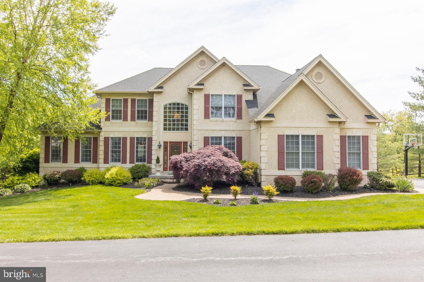 Terrific Executive Home in sought after Westtown Chase on a private lane features both an outstanding location and a magnificent view.   Upgrades galore featuring a spacious eat in kitchen w/ maple cabinets, center island, granite countertops, huge pantry and ceramic tile flooring.    Sunken, open family room with stone fireplace (gas) and back staircase, conservatory/game room w/ vaulted ceilings and ceramic tile floor, open two story entrance way, formal living and dining rooms w/crown molding.  Separate laundry room, powder room and office/den with built-ins round out the first floor.   Spacious 2nd floor owners suite includes sitting area, custom bathroom area with soaking tub and custom walk-in closet with  island.   Three additional bedrooms, one with a private bath and walk in closet plus two more bedrooms that share a jack and jill bathroom.  Exterior upgrades include an oversized 3 car garage and a huge, approximately 14 x 42 foot trex deck offers a panoramic view of the area.    Potential galore in the full house size unfinished, walk-out basement with 9 foot ceilings to include featuring an extra window package for natural light. Roughed in plumbing in place.  Custom stone pavers highlight a walk-out walkway to rear yard and deck.   Three (3) zoned heating/cooling plus upgraded security system with ring doorbell.  A stucco remediation has been completed. Paperwork in documents.