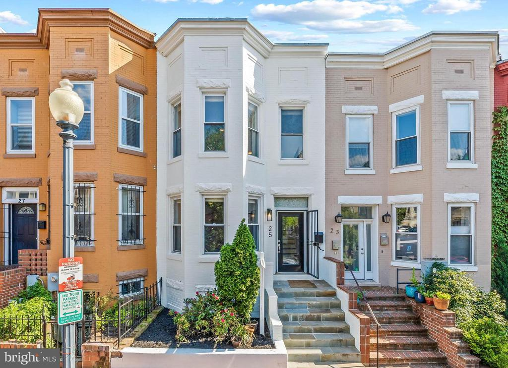**OPEN HOUSES CANCELLED FOR THIS WEEKEND (5/29) & (5/30)**Beautifully updated 4BR/3.5BA rowhouse with private outdoor space and parking! Located at 25 Todd Pl NE, this lovely rowhouse features hardwood floors, beautiful natural light, tall ceilings, and exposed brick. The main level layout is ideal for entertaining with a spacious living space, separate dining area, powder room, and modern kitchen featuring ample cabinet space, quartz counters, stainless appliances, and gas cooking. The main level also has access to your large private deck and RESERVED PARKING! Upstairs, relax in the large primary bedroom suite with a flood of sunshine from the bay window, two closets, and a full en-suite bathroom with an updated shower, vanity, and lighting. Down the hall, there are two large additional bedrooms and a full bathroom. The versatile lower level has additional living space which can be a separate bedroom, full bathroom, kitchenette, and exterior entrance. It's perfect to use as a home office, in-law suite, or a way to generate AirBnB income! You'll love the location - close to several parks (Harry Thomas Recreation Center & POOL!), schools, restaurants (Red Hen! Big Bear Cafe!) and so much more!