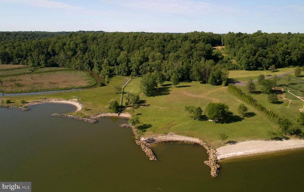 One of a kind gem on a breath-taking panoramic point of the Potomac River. With 5 acres of waterfront property (additional 5 acres of waterfront land adjacent to subject property is for sale as well, both parcels may be purchased together for $2,200,000). Located just 20 minutes from Downtown Fredericksburg on the scenic Belvedere Beach, this land has been perced for 4 bedrooms and ready to support your dream home and sprawling pier. Ripe with history, this land was the home of the Belvedere Hotel and Casino. People from all over, with the likes of Patsy Cline and George Jones, would travel by boat and car to the Hotel and enjoy everything from live bands, gambling, fine whiskey, and beautiful views. Once a central hub for travelers and thrill-seekers, this land has cultivated culture renowned in Virginia since the early 1900s. The current owners have amassed a collection of news articles about the land dating back to 1926.  With 470 feet of prime water frontage and beach, paradise is just a leisurely stroll through your back yard or viewing from the comfort of your newly built dream home. The current owner has installed and maintained rip raps and has meticulously cared for the beach. This land is perfect for the water lover, as it is the ideal spot for shells and shark teeth to wash ashore.  Enjoy the comfort of a quiet community with a front gate and well-maintained and paved roads in an area where the only noise you can be accustomed to is the ebb and flow of the Potomac River. A 200ft pier was permitted and can include two boat lifts. Quick access to Fairview Beach and Hope Springs Marinas, as well as local waterfront bars and restaurants. Your waterfront paradise awaits!