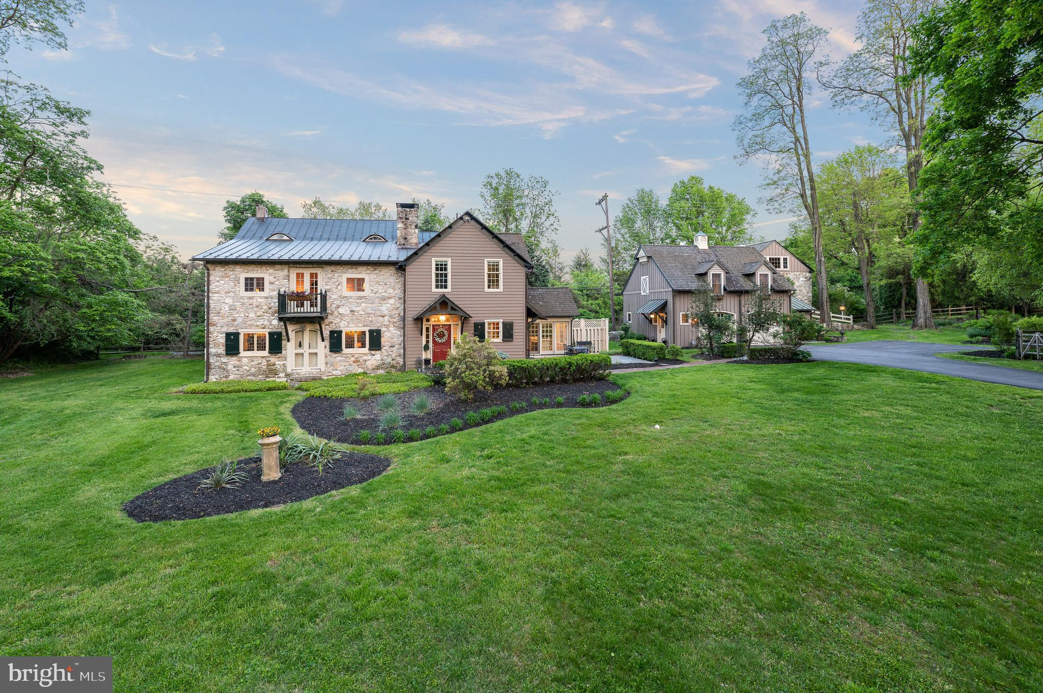 """Recently featured by PhillyMag.com! https://www.phillymag.com/property/2021/04/07malvern-expanded-colonial-farmhouse-for-sale/. Presenting """"Le Petit Bois""""-a sophisticated historic farmhouse with a European flair that has been meticulously expanded and updated over the centuries. The original home is believed to date prior to the 1730's. In the 1800's a French professor created the first enchanting addition while Peter Zimmerman Architects seamlessly blended the most recent elegant addition in the mid 1990's. Delightfully poised on 3.7 lush and serene acres, this property also offers a spectacular Guest House, a Pool surrounded by slate patio, Pool Cabana, English Greenhouse, over-sized 2 car garage, Potting Shed and the original Barn which is ideal for all of your storage needs. This 4-5 Bedroom, 3.5 Bathroom masterpiece offers today's Buyers the amenities they desire while retaining the authenticity and character seldom found in present times. Inside the main home, discover restored and original random width hardwood flooring, walls with exposed stone, original hardware, hand hewn ceiling beams, an impressive walk-in stone fireplace, stained glass lead windows, 2 staircases, great closet space, terrific flow and so much more. The first floor includes a light filled gourmet Kitchen with a Breakfast Room surrounded by expansive windows, an adjacent Dining Room with original period antique corner cupboards, a generous sized Great Room with an incredible stone wood burning fireplace, an Office with a wet bar and fireplace, a graceful Entry Foyer, Powder Room and a convenient Mud Room with cubbies.  Up the main stairs, with an entire wall of exposed original stone, the beautiful Primary Suite includes a cathedral ceiling with beams, a cheerful Bath and a large walk-in closet. Two additional Bedrooms, one was the former master bedroom with walk in closet and the other is currently used as a 2nd floor Den, a lovely large Jack n Jill Bath with shower and tub and the Laundr"""